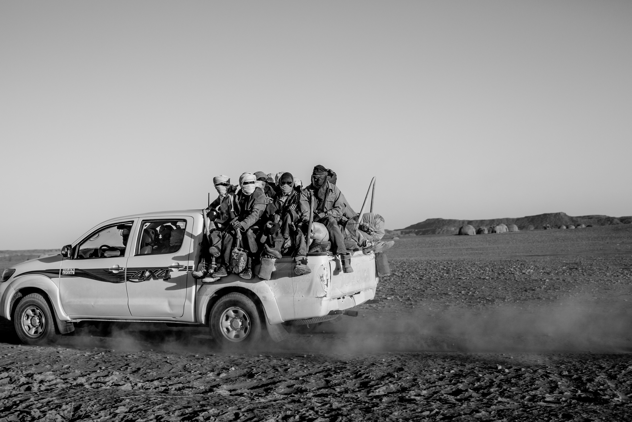 Migrants are stuffed into the back of a pickup truck as they begin the first day of their five day journey across the Sahara to Libya, in Niger on April 20, 2015.