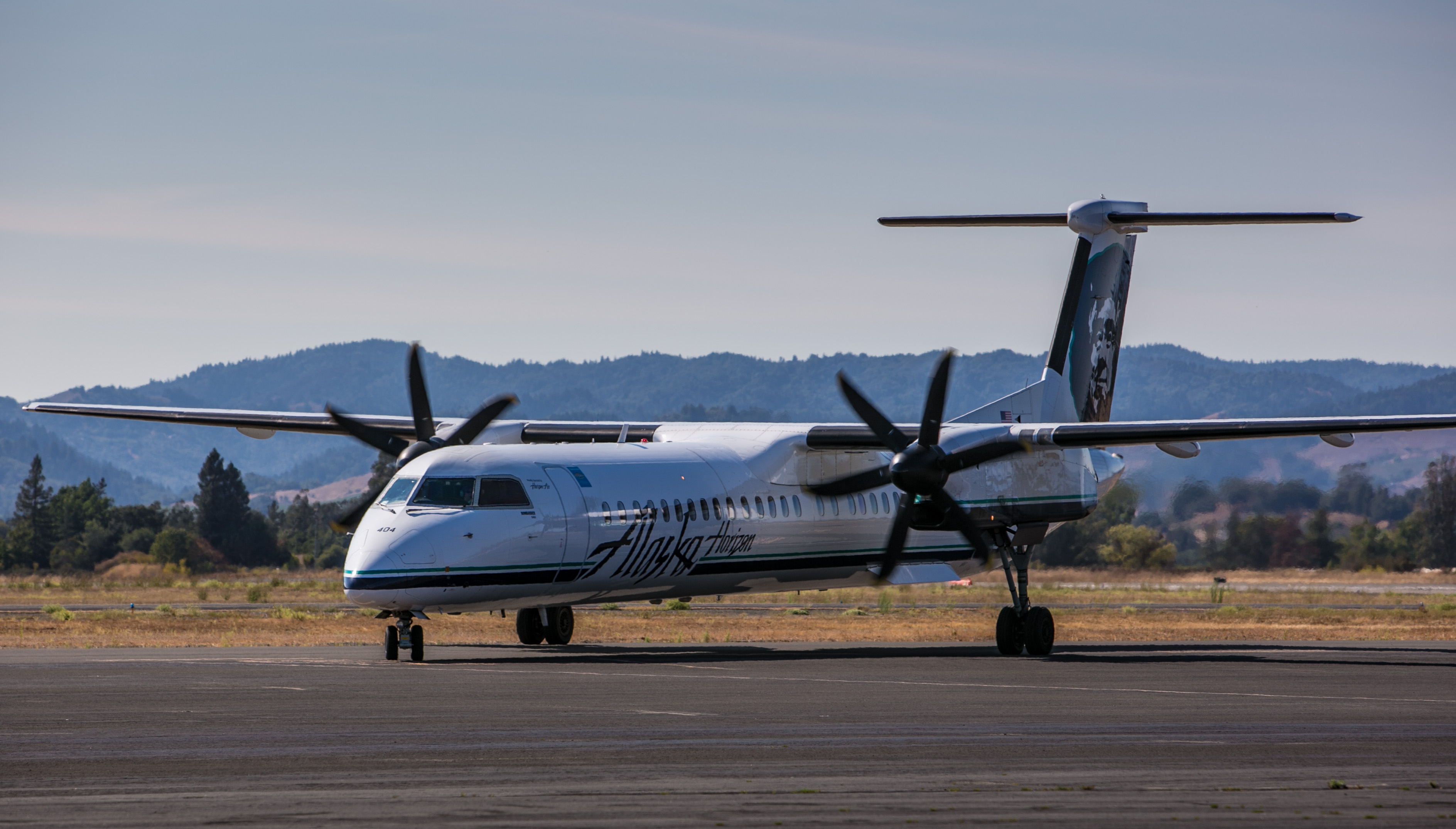An Alaska Airlines Bombardier Q-400 regional turbo prop plane pulls into the gate at Charles M. Schulz Airport on August 27, 2014, near Healdsburg, California.