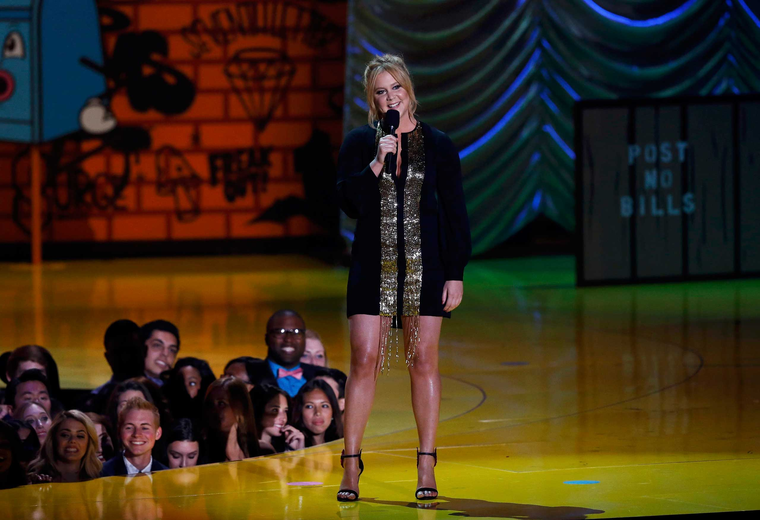 Host Amy Schumer opens the show at the 2015 MTV Movie Awards in Los Angeles on Apr. 12, 2015.