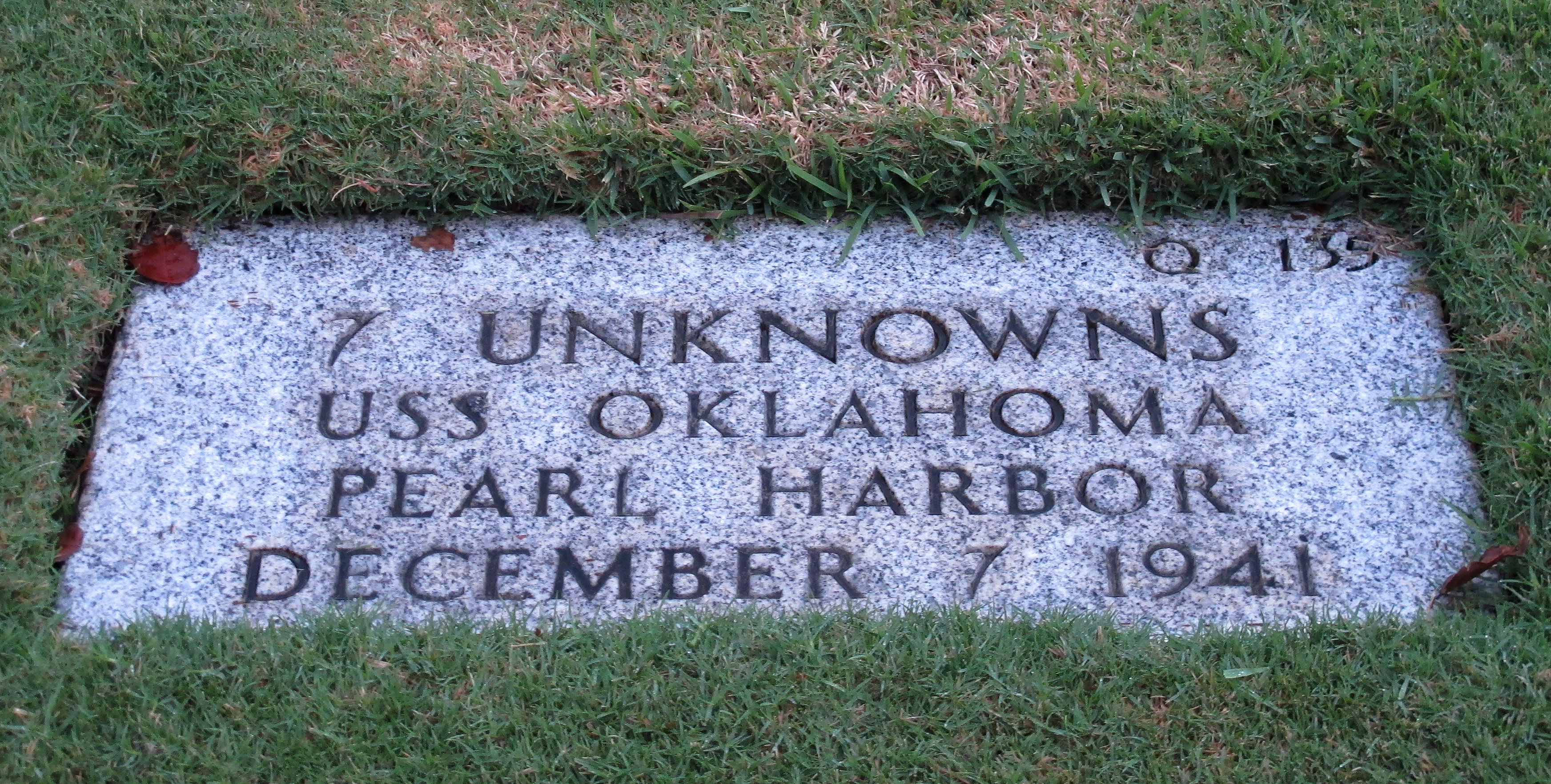 This Dec. 5, 2012 photo at the National Memorial Cemetery of the Pacific in Honolulu shows a gravestone  of 7 unknowns from the USS Oklahoma