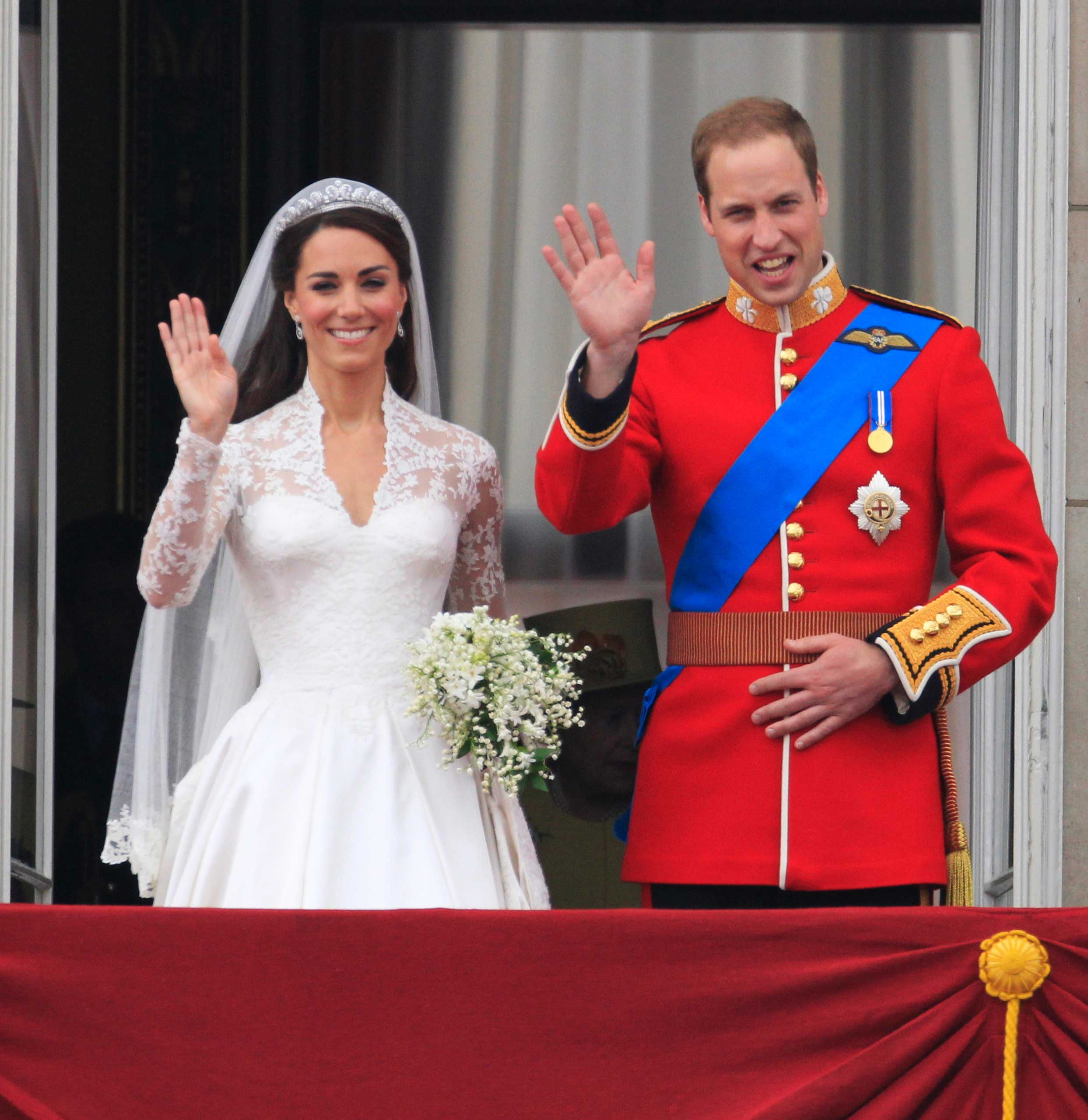 Britain's Prince William and his wife Kate, Duchess of Cambridge wave from the balcony of Buckingham Palace after the Royal Wedding in London April, 29, 2011.