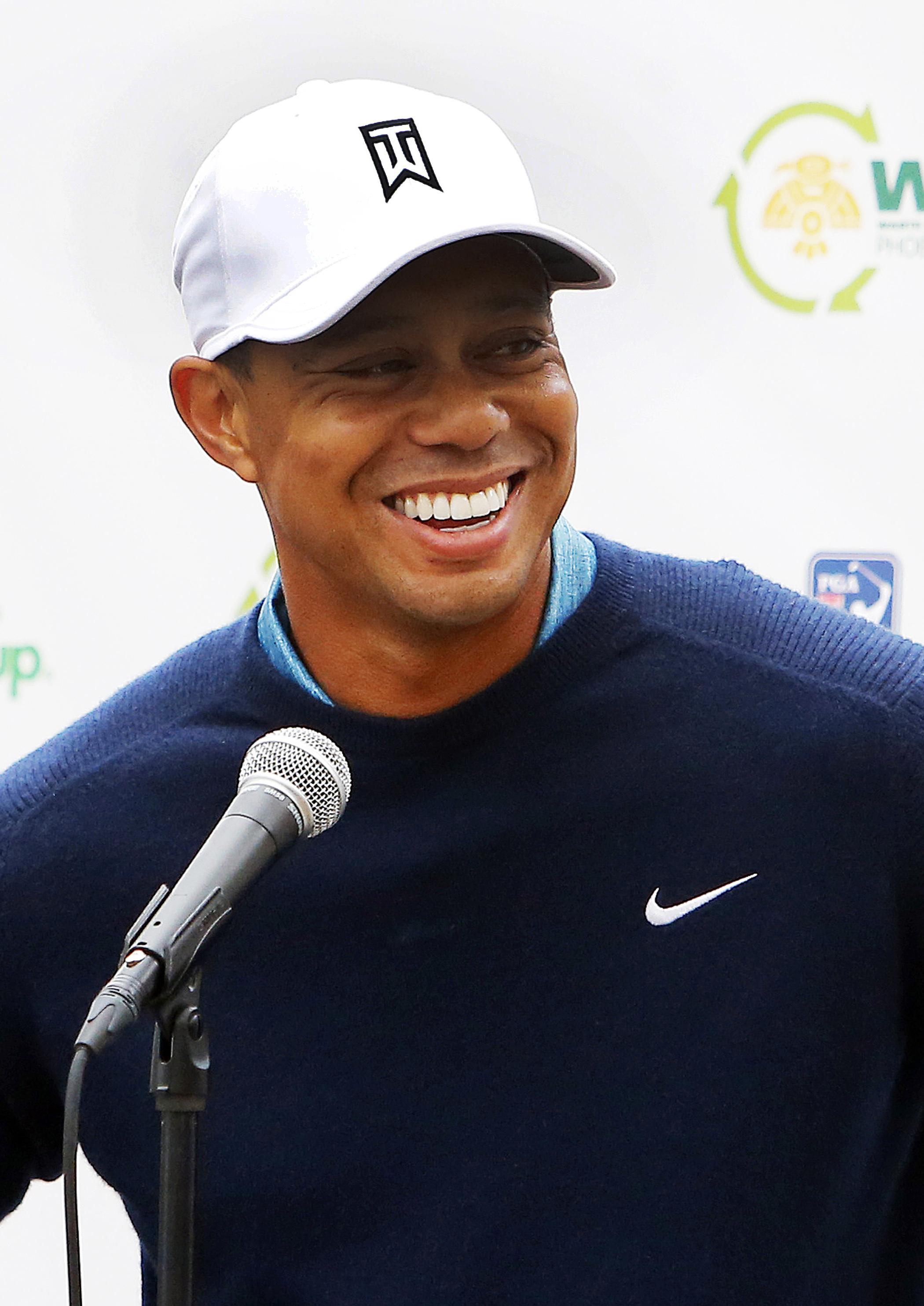Tiger Woods talks to the media in Scottsdale, Ariz. on Jan. 27, 2015.