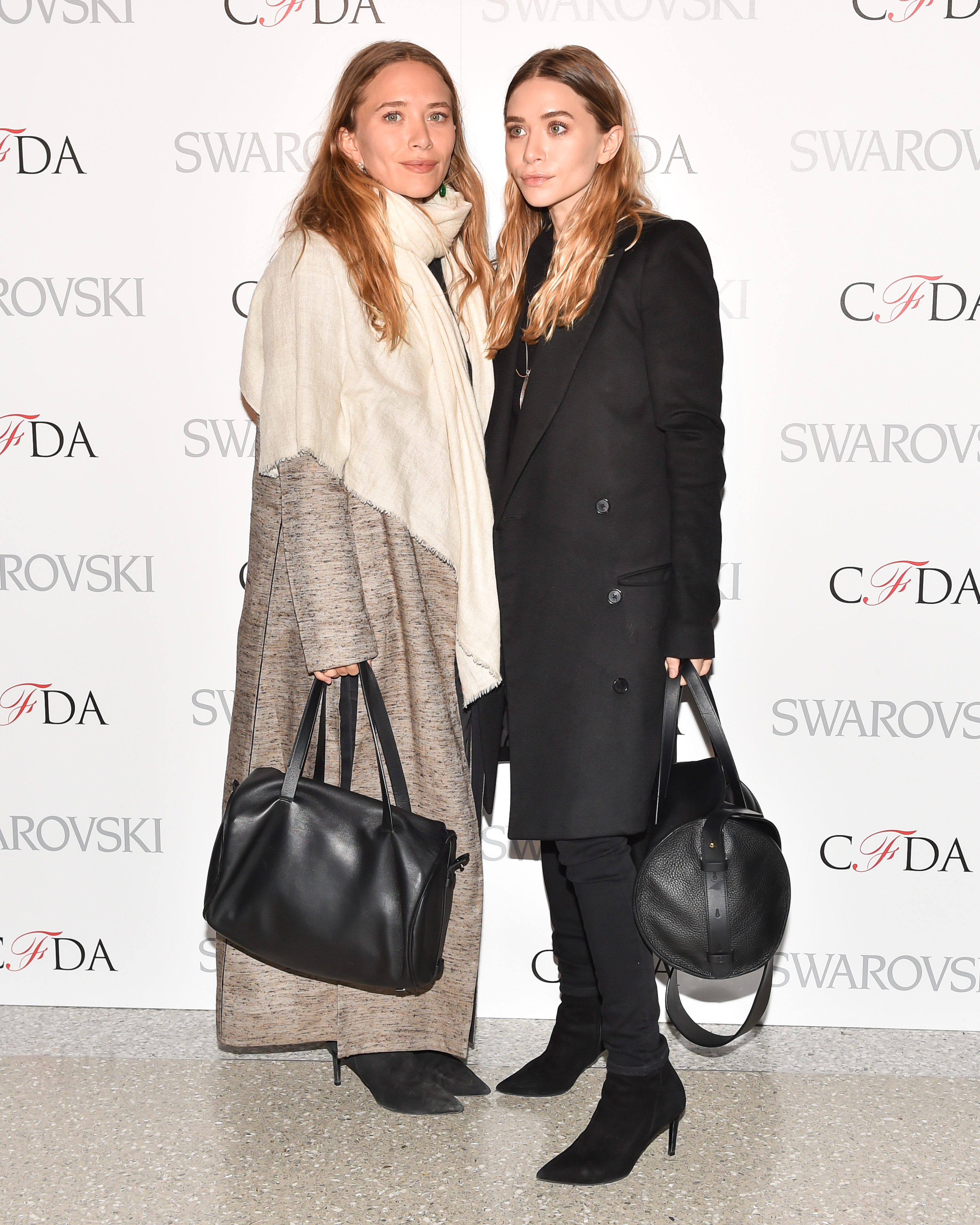 Mary-Kate Olsen (L) and Ashley Olsen attend 2015 CFDA Fashion Awards Announcement Party in New York City on March 16, 2015.