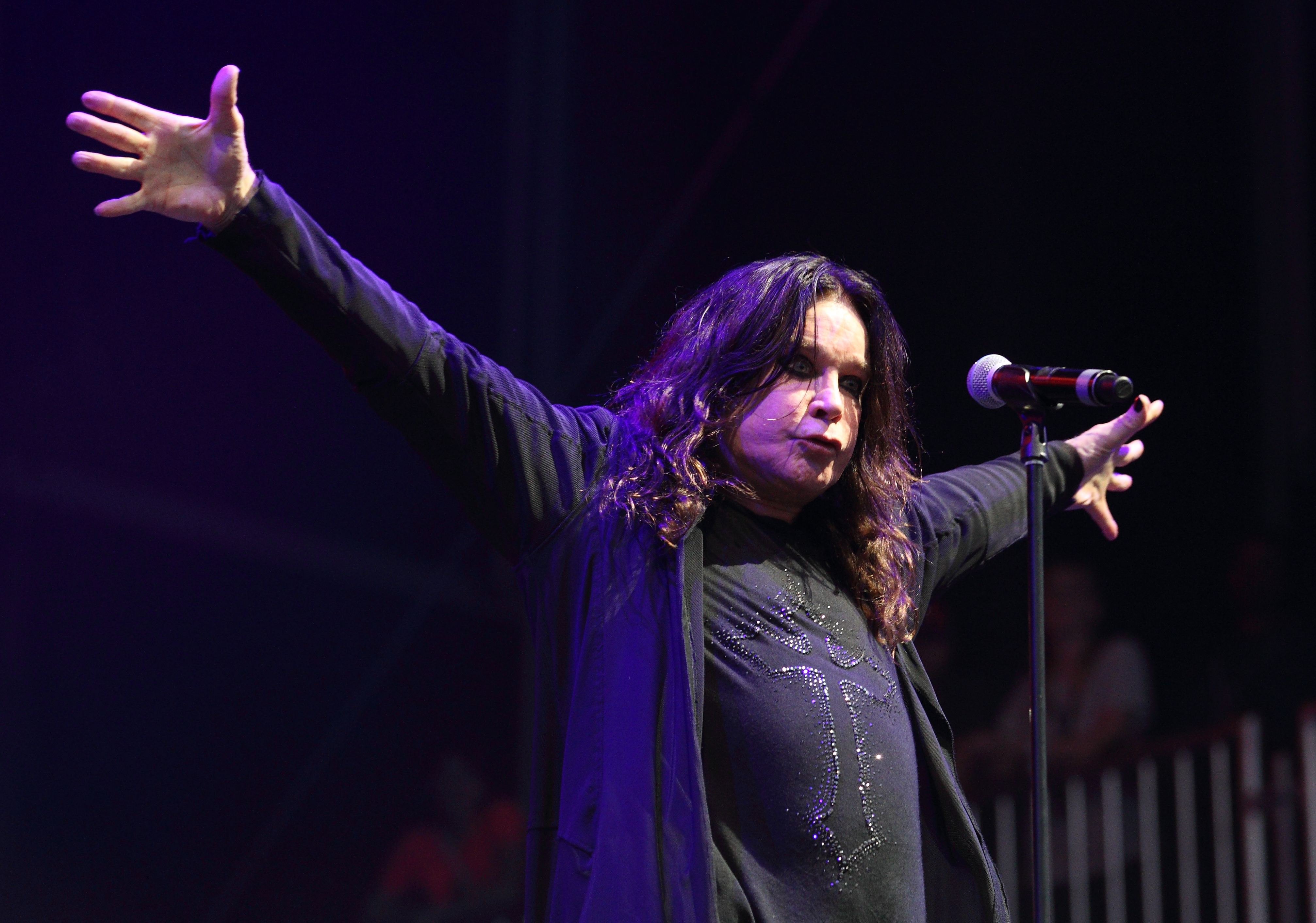 This Aug. 3, 2012 file photo shows Ozzy Osbourne of Black Sabbath performing at the Lollapalooza festival in Chicago's Grant Park