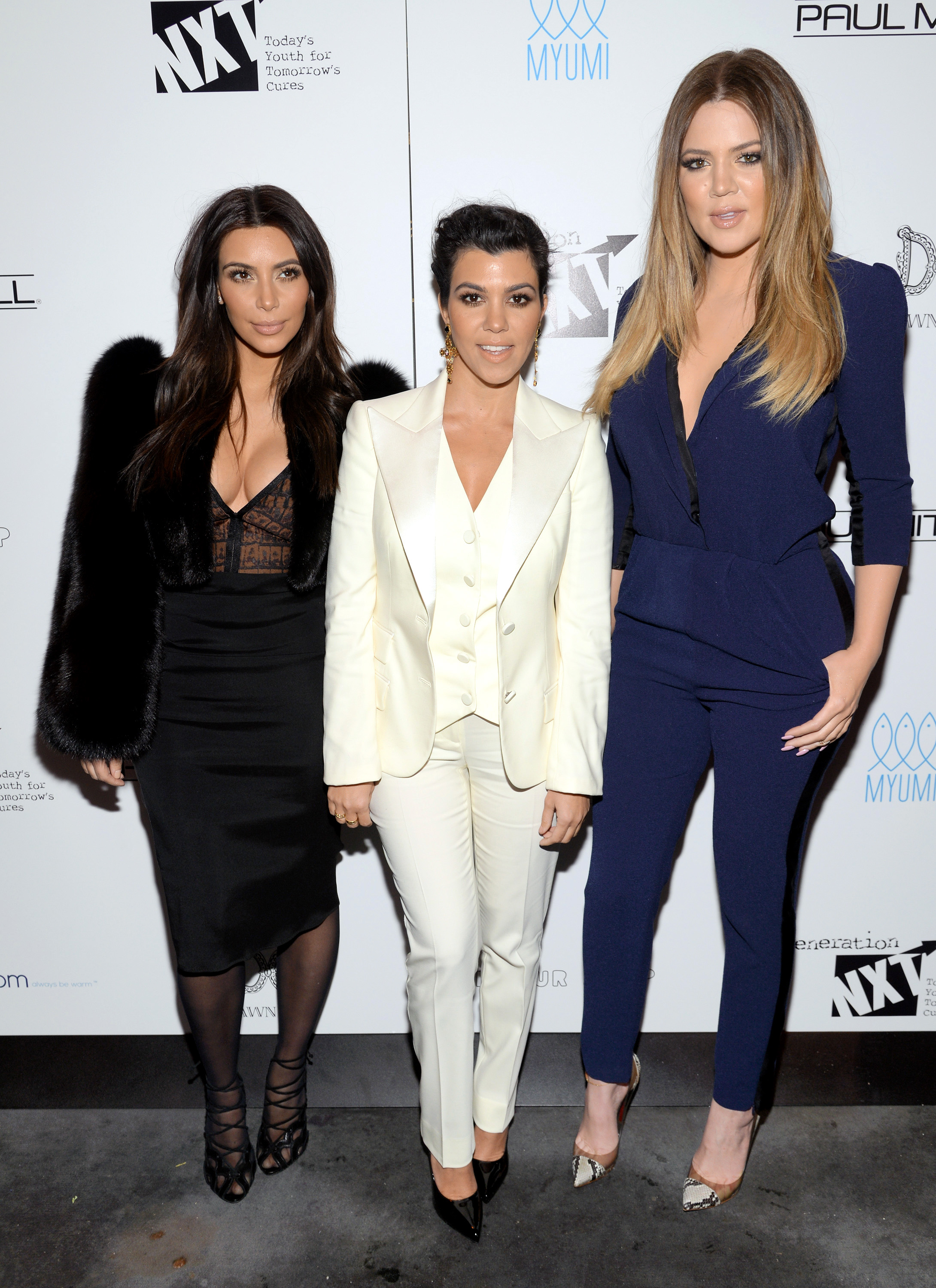 Television personalities Kim Kardashian, left, Kourtney Kardashian and Khloe Kardashian Odom, right, attend a Generation NXT Dream Foundation benefit event in New York on Feb. 16, 2014.