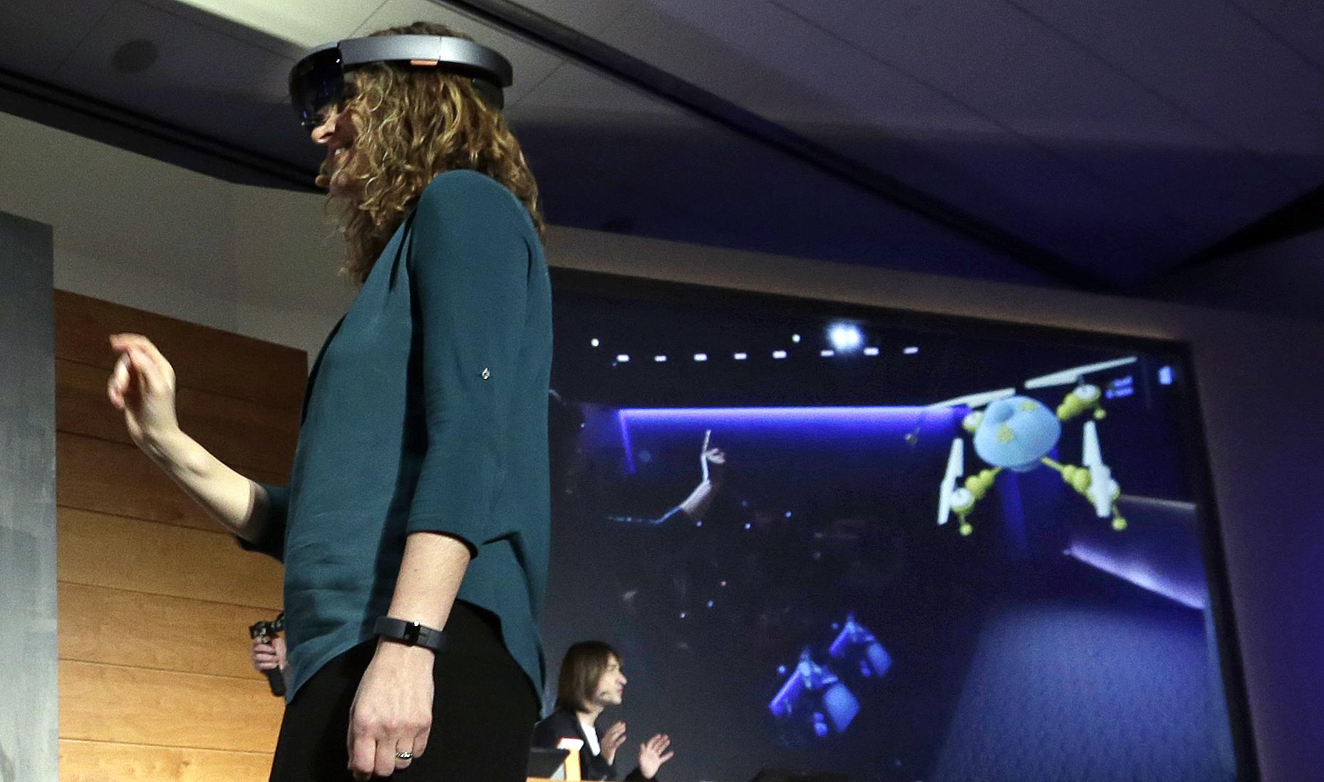 Microsoft's Lorraine Bardeen demonstrates the new Microsoft HoloLens headset in Redmond, Wash. on Jan. 21, 2015.