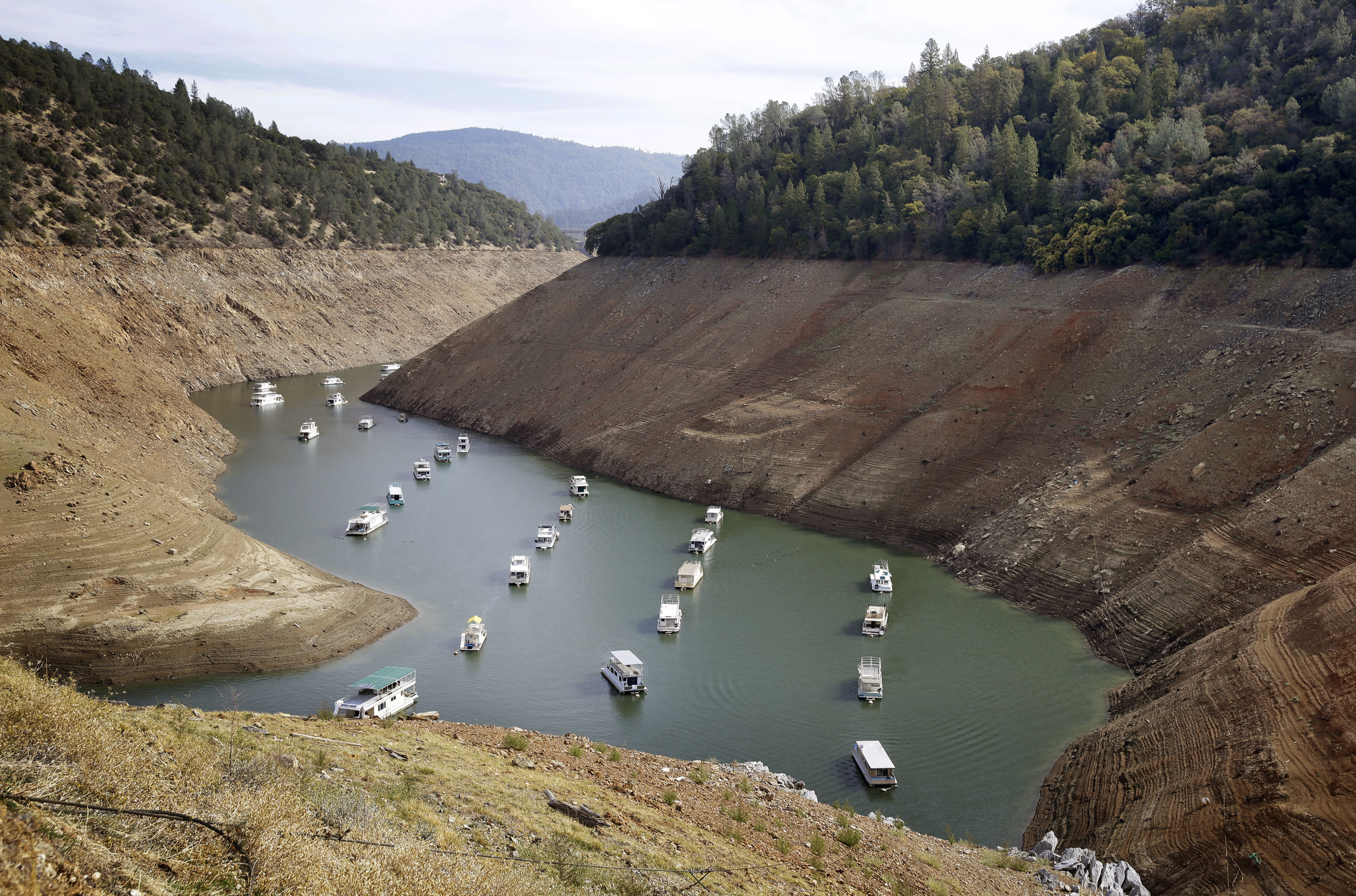 Houseboats float in the drought-lowered waters of Oroville Lake near Oroville, Calif., Oct. 30, 2014. Gov. Jerry Brown on April 1, 2015, ordered sweeping and unprecedented measures to save water in California.