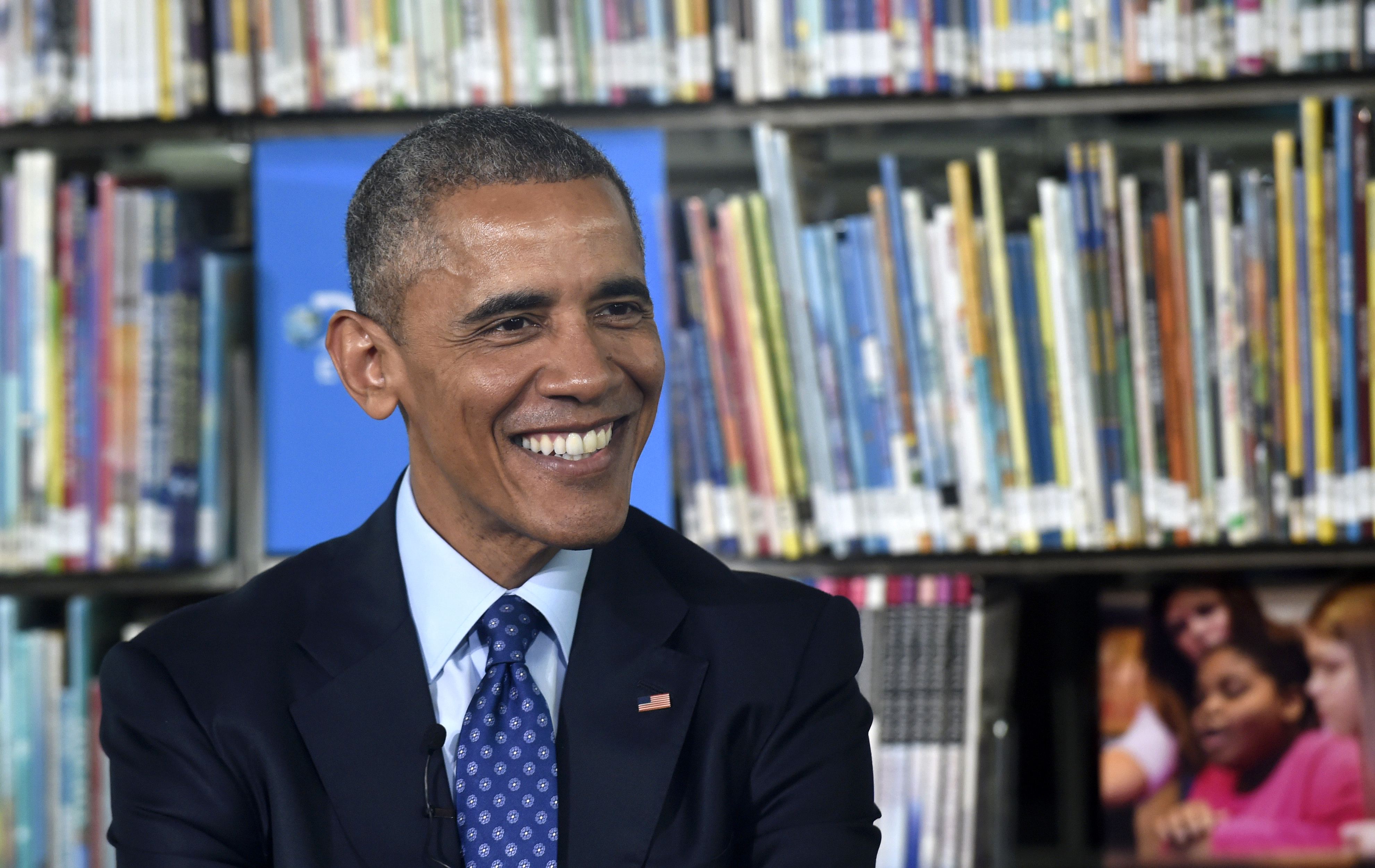 President Barack Obama smiles as he speaks at Anacostia Library in Washington, Thursday, April 30, 2015