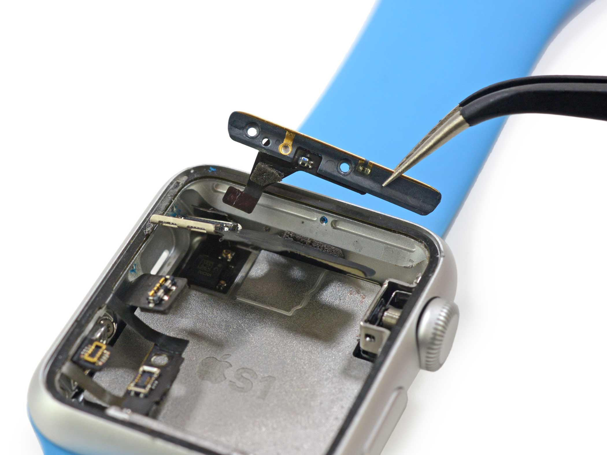 The antenna assembly is removed, which likely controls the watch's Wi-Fi and Bluetooth functionality