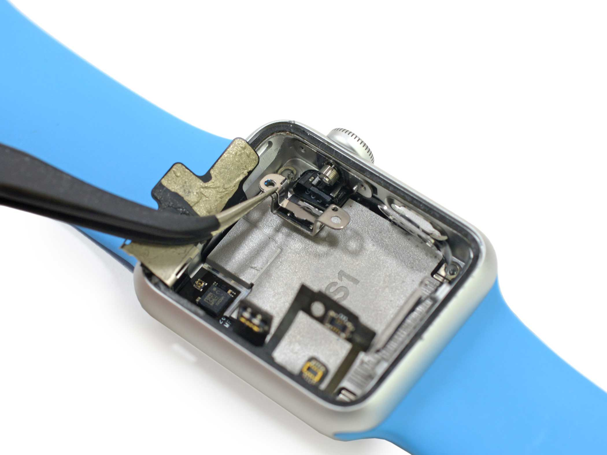 Removing the digital crown bracket is the final step before having access to the Apple Watch's integrated computer chip, the S1