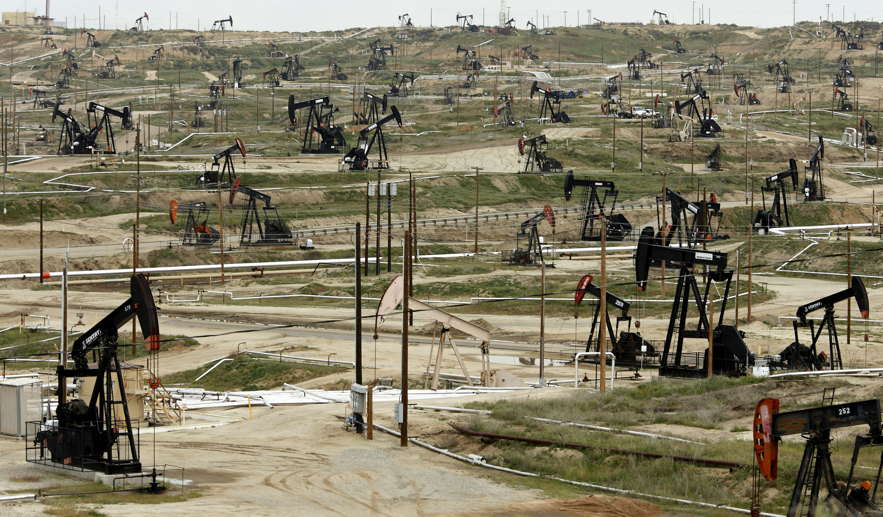 Oil pumps stand at the Chevron Corp. Kern River oil field in Bakersfield, Calif.