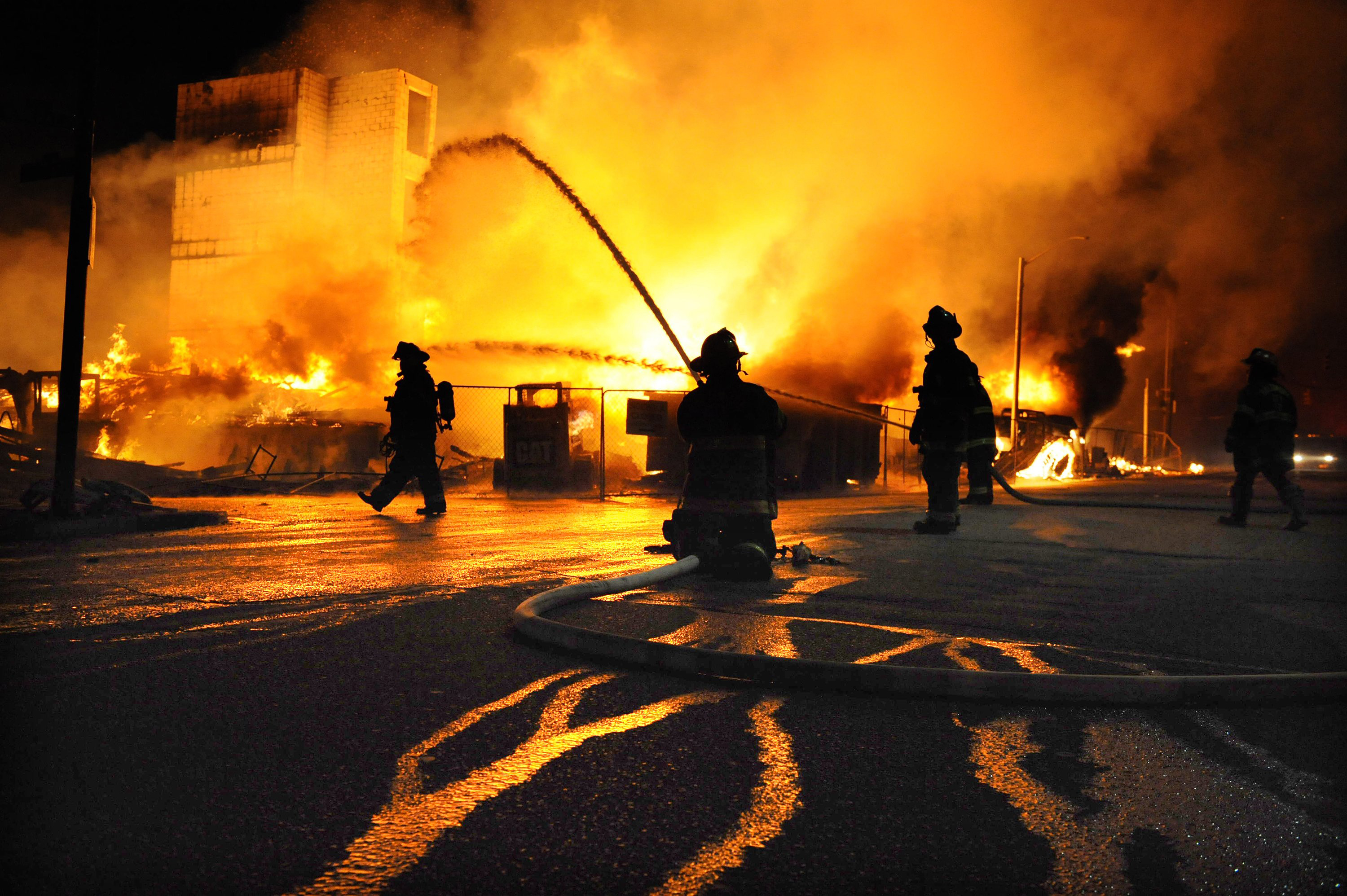 Firefighters battle a blaze after riots in Baltimore on  April 27, 2015.
