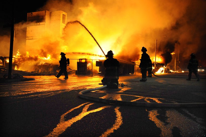 Firefighters battle a blaze after riots in Baltimore