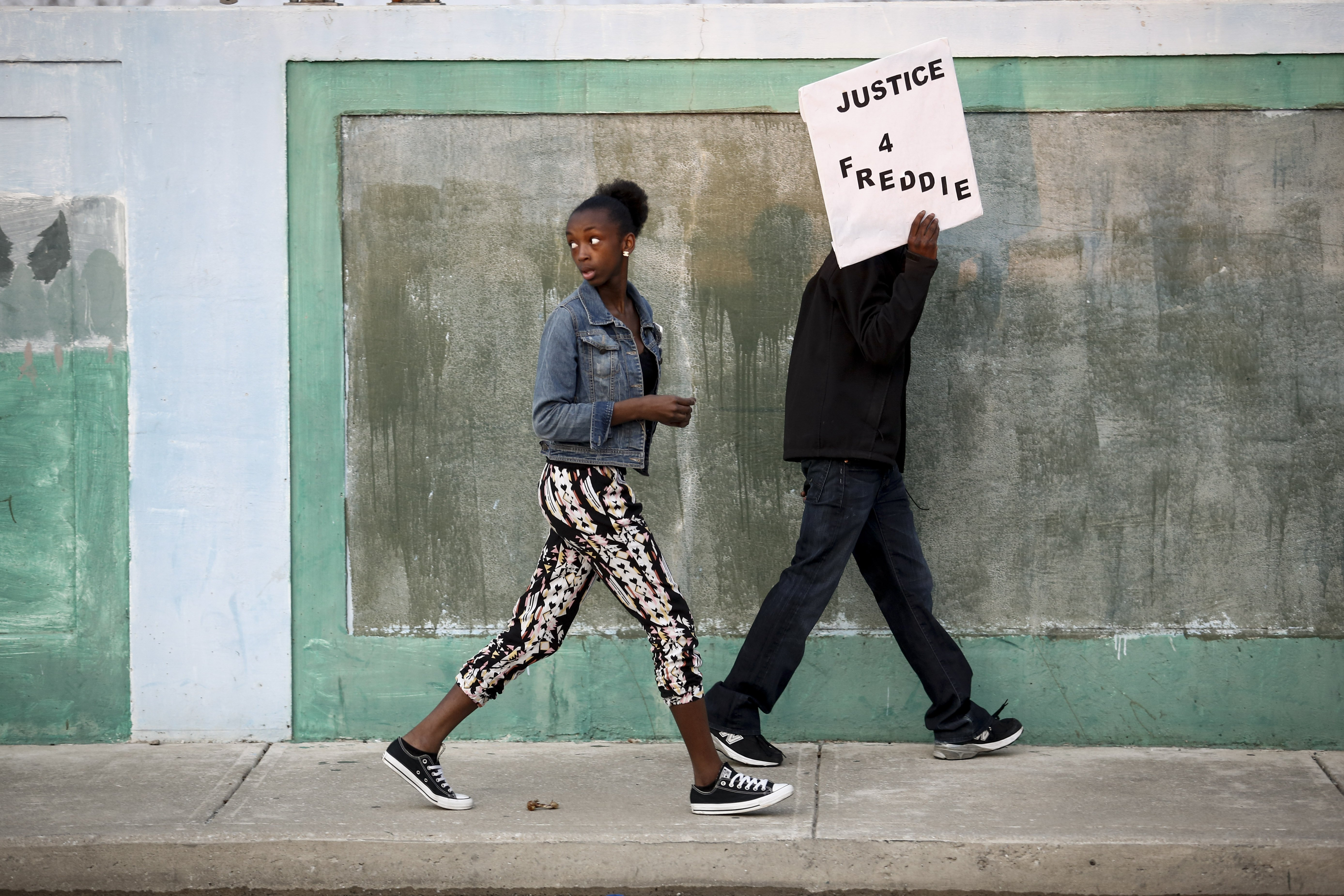 Protestors walk toward Baltimore Police Department's Western District police station during a march and vigil over the death of Freddie Gray in Baltimore on April 21, 2015.