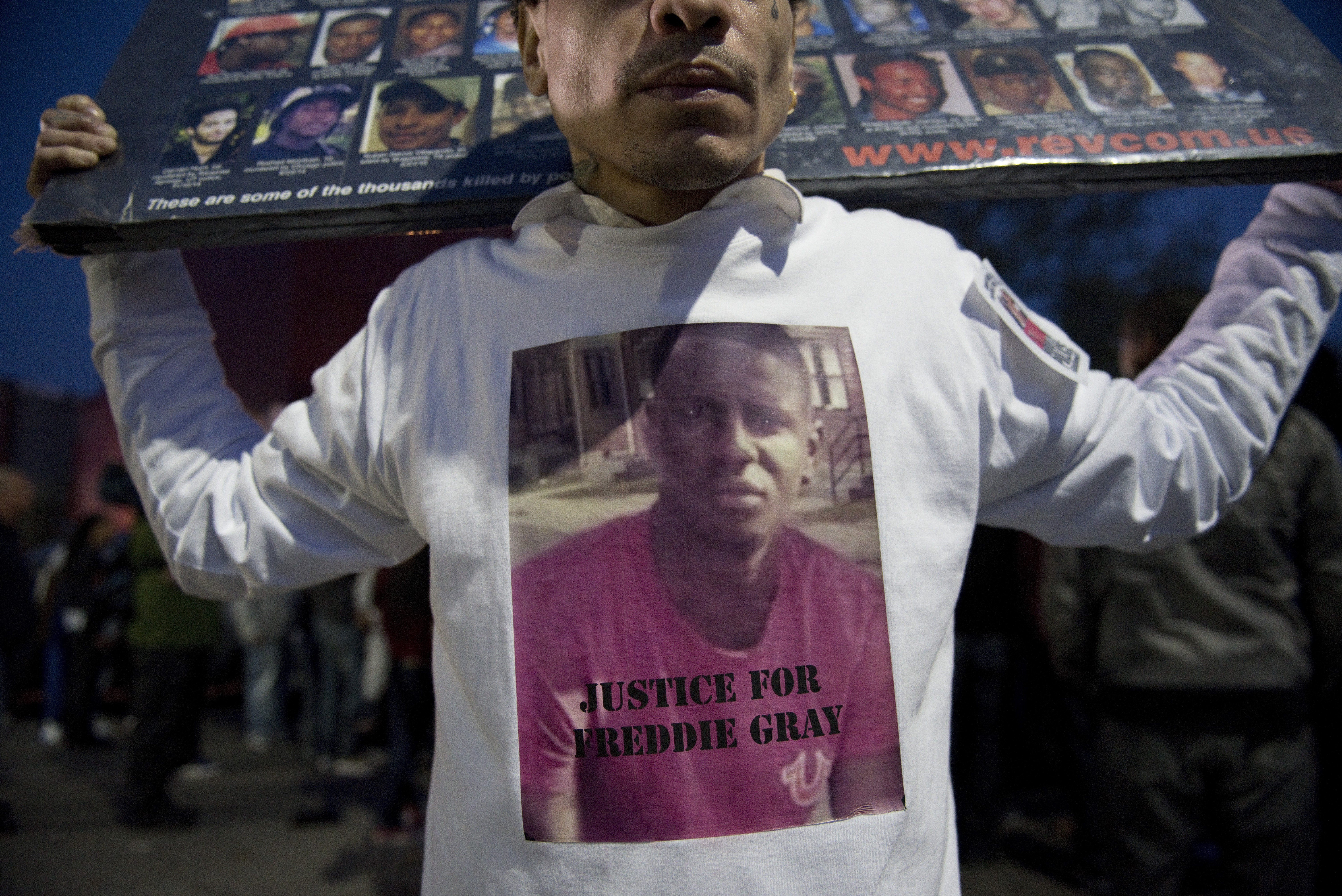 A protester holds a sign during a rally for Freddie Gray outside Baltimore Police Department Western District station in Baltimore on April 22, 2015.