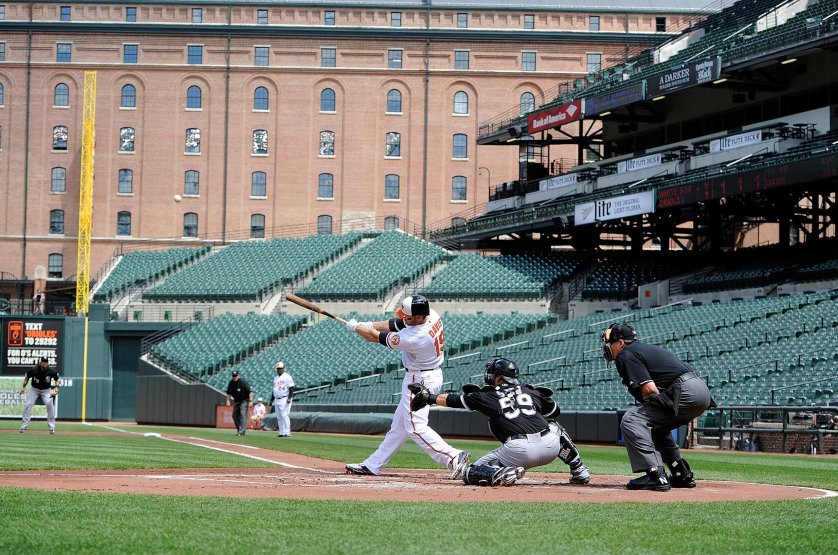 Chris Davis #19 of the Baltimore Orioles hits a three-run home run in the first inning against the Chicago White Sox at Oriole Park at Camden Yards in Baltimore on April 29, 2015.