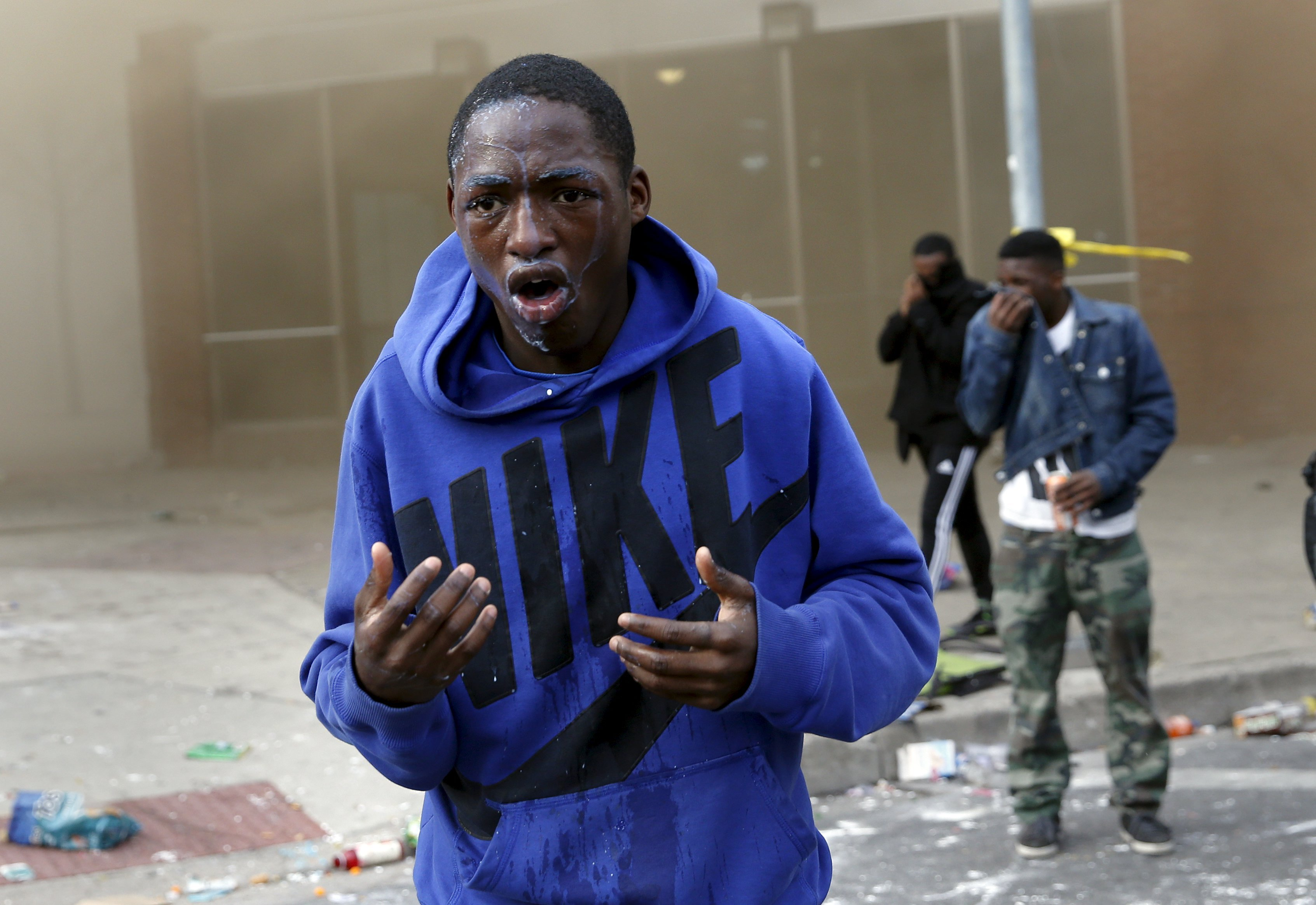 A demonstrator looks up after being sprayed with pepper spray during clashes in Baltimore on April 27, 2015.