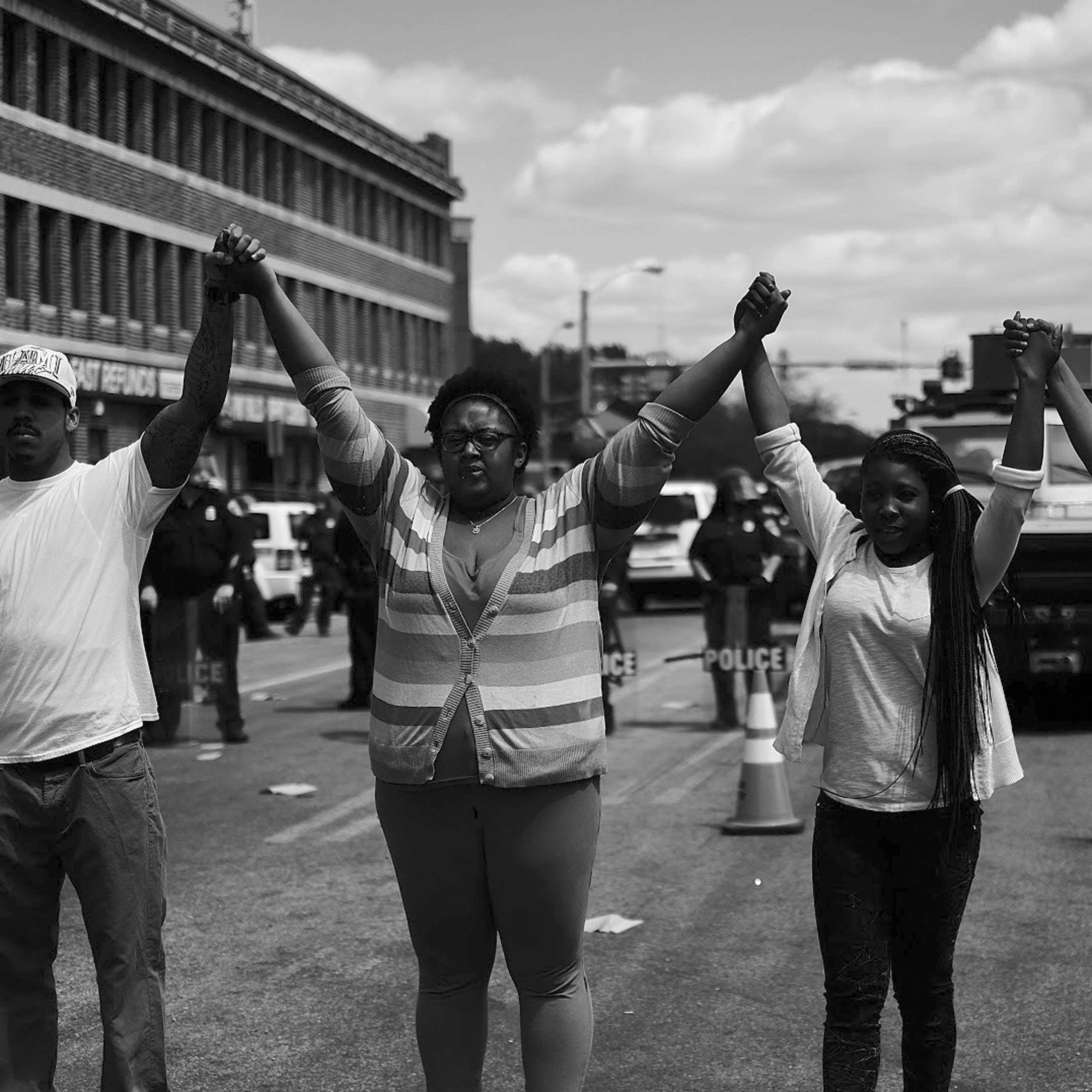 Neighborhood residents create a peace circle, near North ave and Fulton in Baltimore on April 28, 2015.