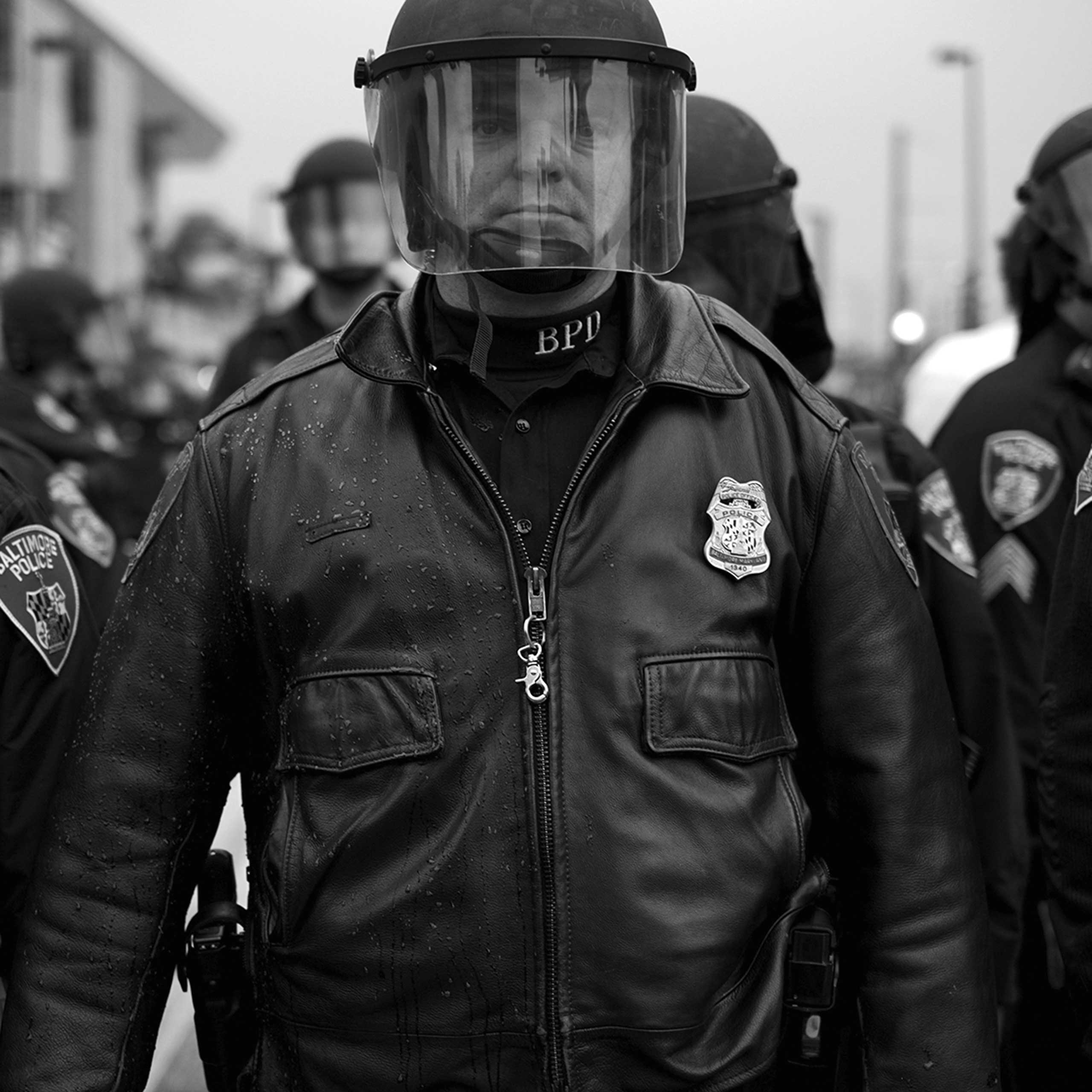 A police officer stands guard during protests in Baltimore on April 26, 2015.