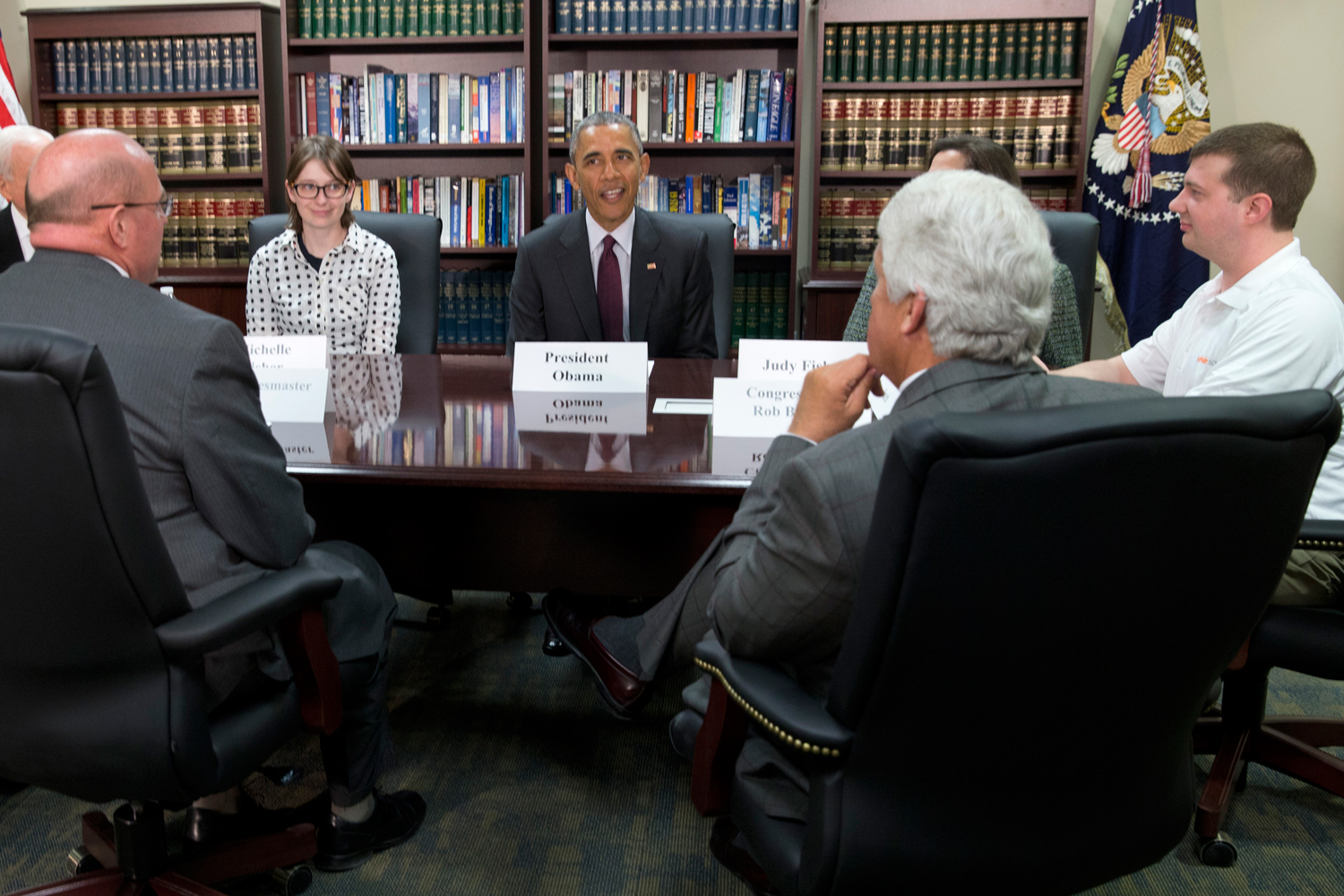 In this April 3, 2015, file photo, President Barack Obama, center, participates in a roundtable about clean energy with Judy Fisher, clockwise from Obama, Marvin Lance Futch, Rep. Rob Bishop, R-Utah, Harry  Buddy  Briesmaster III, Sen. Orrin Hatch, R-Utah, and Michelle Fisher at Hill Air Force Base, Utah.