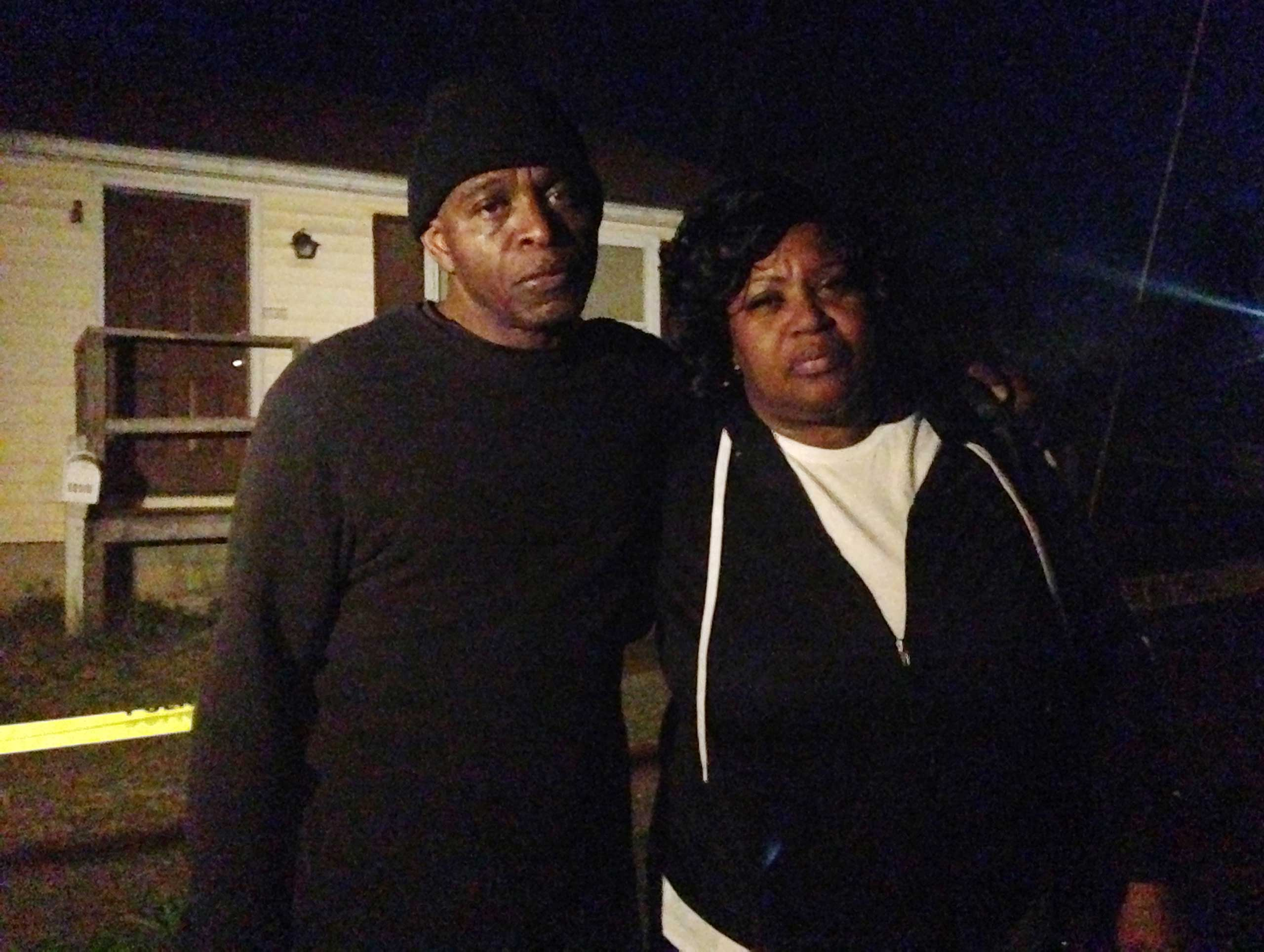 Lloyd Edwards, left, and Bonnie Edwards, the stepfather and mother of Rodney Todd stand outside the home where Todd and his seven children found dead Monday, April 6, 2015, in Princess Anne, Md.
