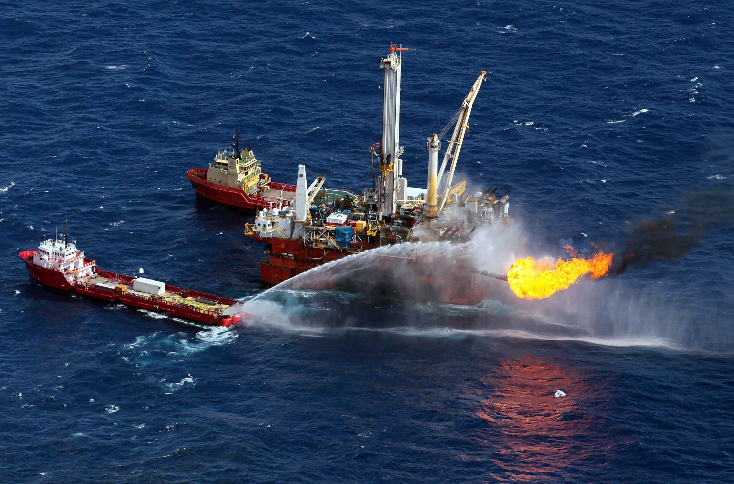 Support ships are seen near where efforts continue to recover oil and cap the Deepwater Horizon spill site in the Gulf of Mexico off the coast of Louisiana on July 3, 2010.