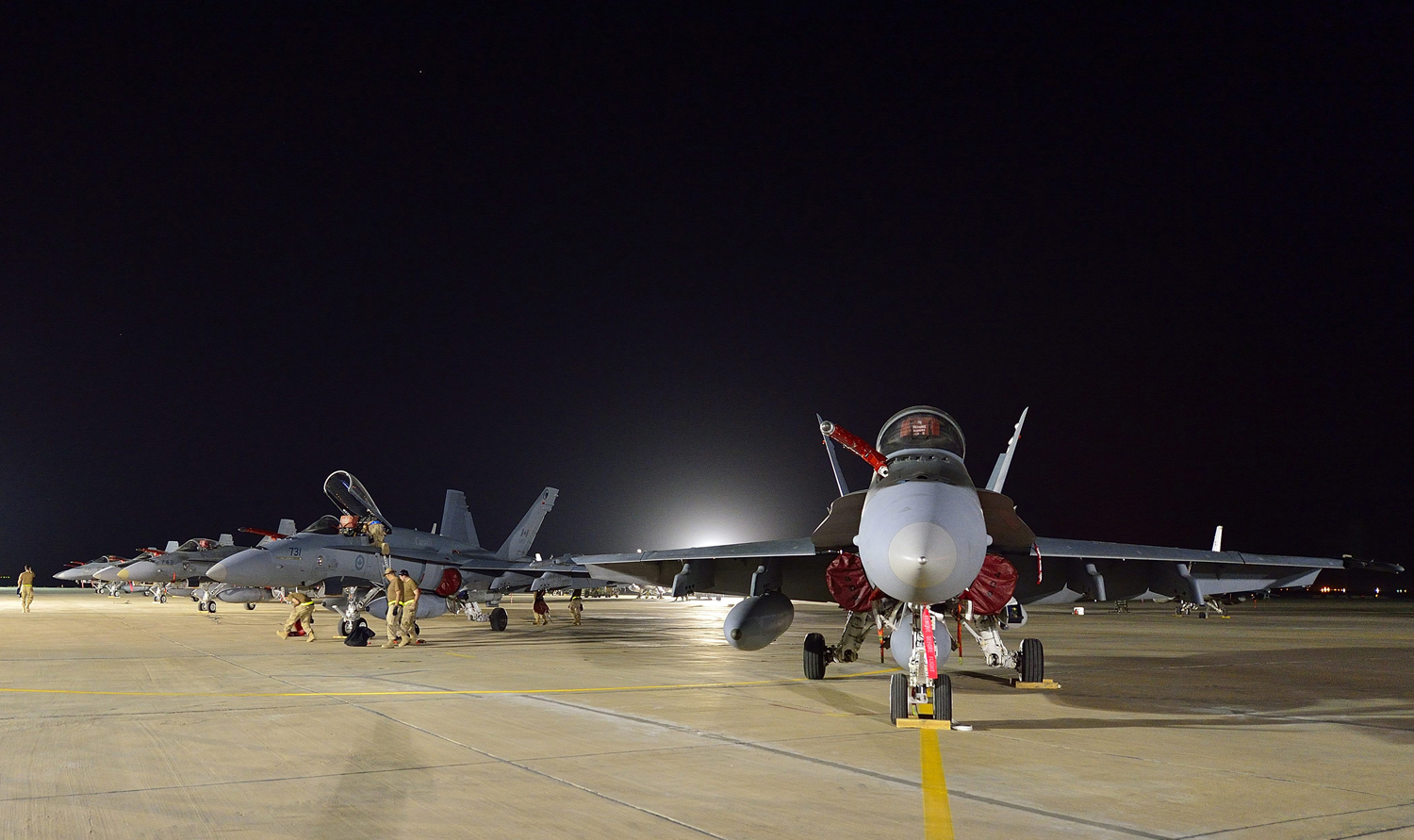 Canadian Armed Forces CF-18 fighter jets arrive at the Canadian Air Task Force Flight Operations Area in Kuwait on October 28, 2014 .