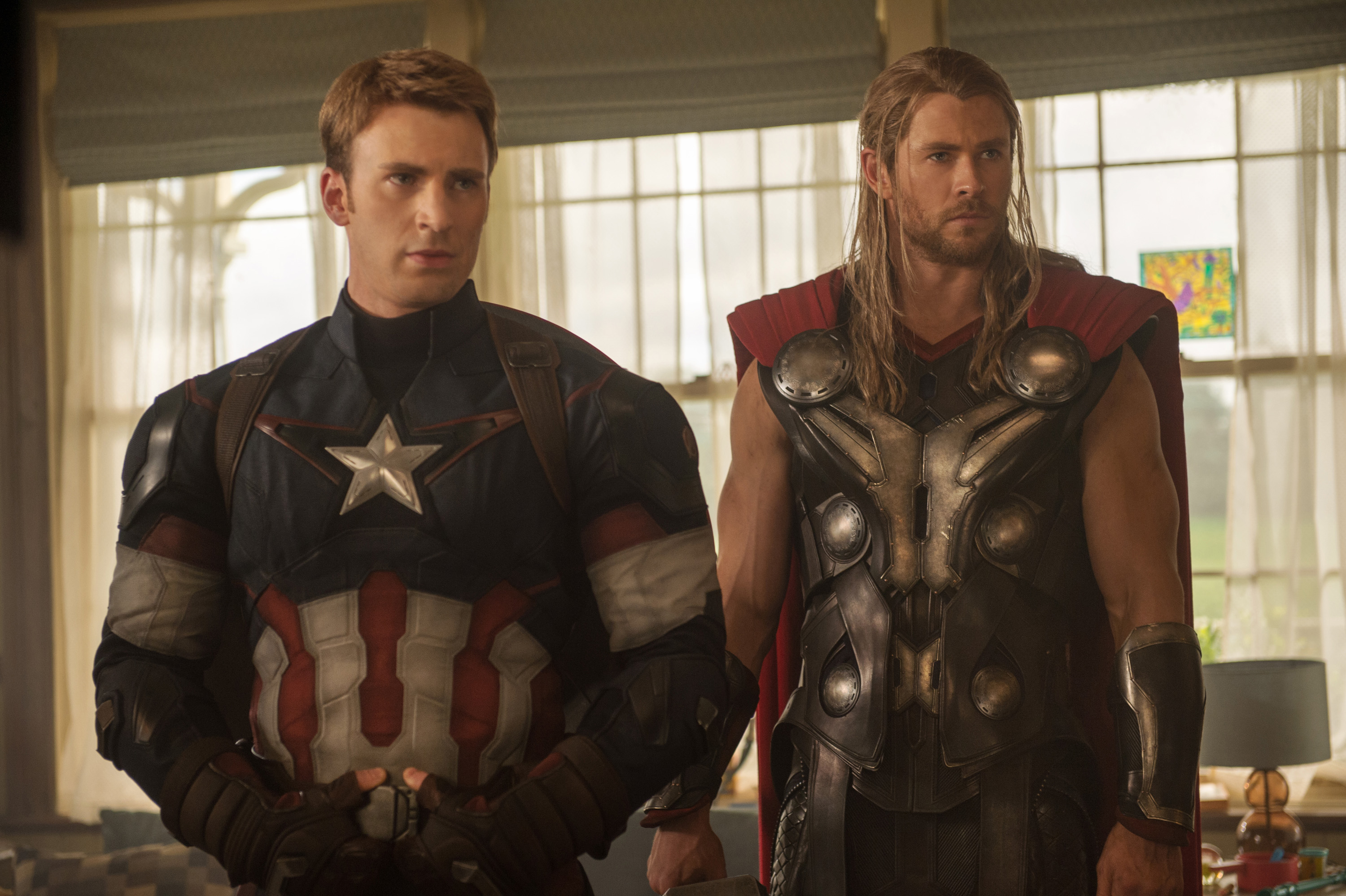 This photo provided by Disney/Marvel shows, Chris Evans, left, as Captain America/Steve Rogers, and Chris Hemsworth as Thor, in the new film,  Avengers: Age Of Ultron.