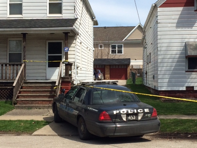Authorities investigate the scene after a shooting involving two children Sunday, April 12, 2015, in Cleveland.