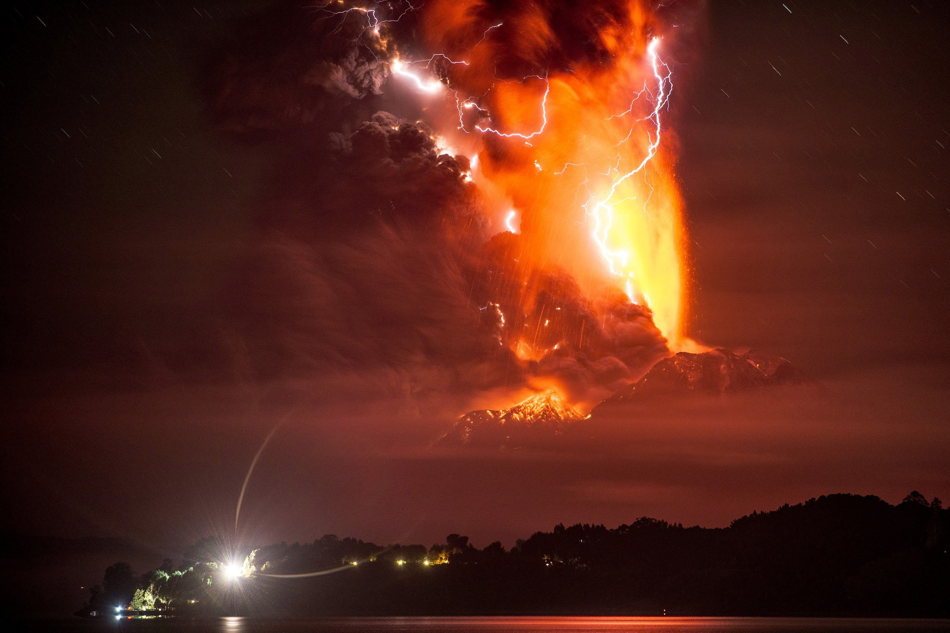 Lava and lightning illuminate a cloud of ash during an eruption of the Calbuco volcano on April 23, 2015.