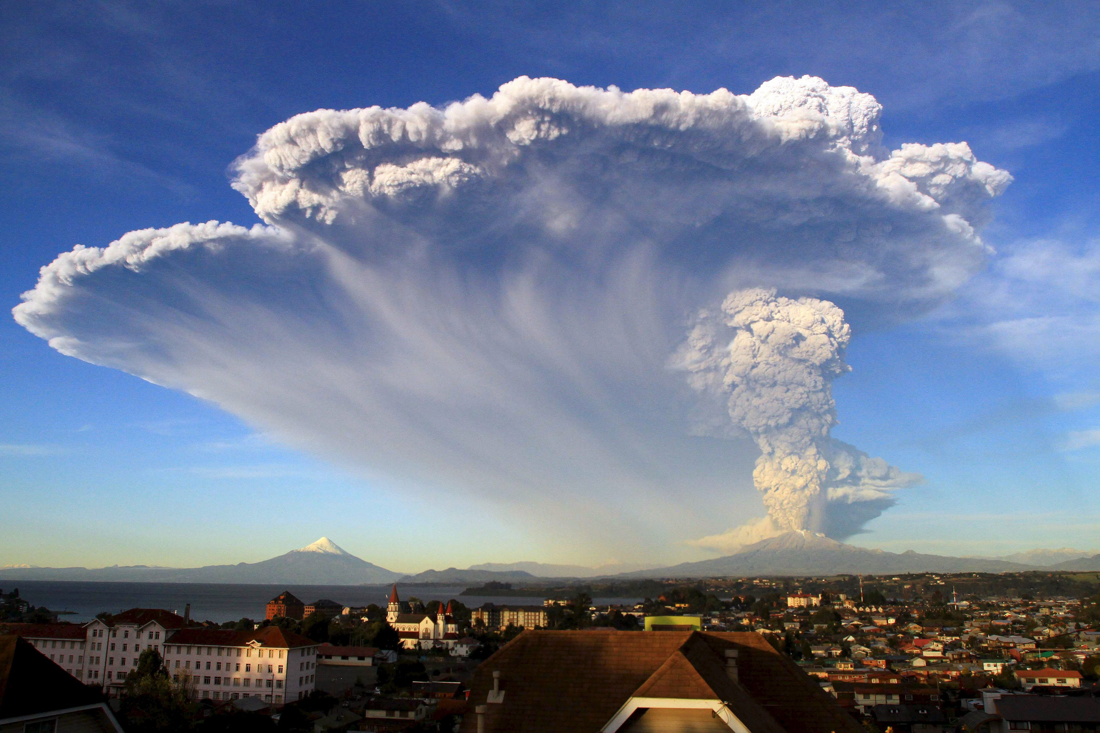 Ash rises from the Calbuco volcano, seen from Puerto Varas, just miles north of the eruption, April 22, 2015.