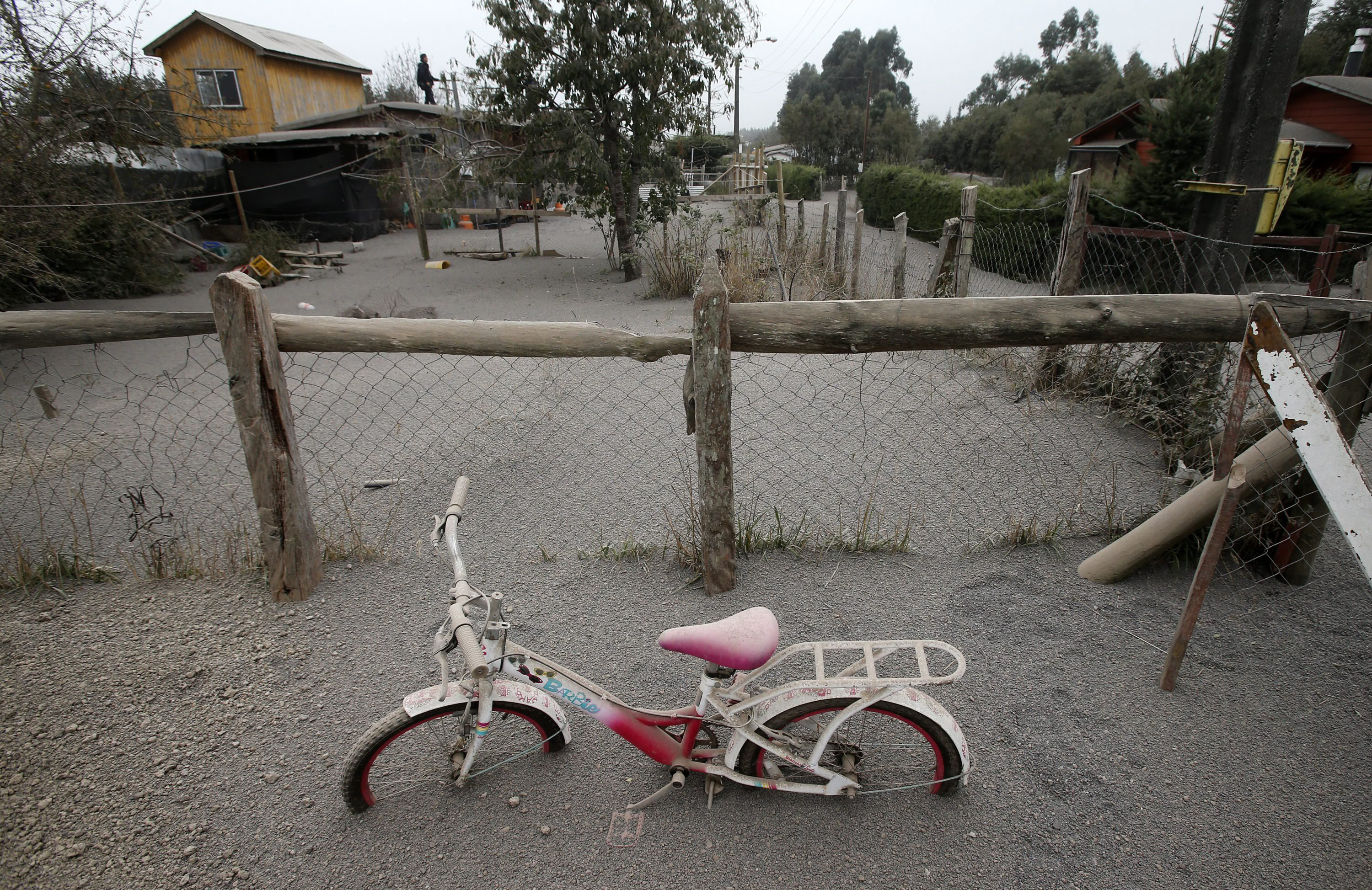 A child's bicycle sits covered in ash on the outskirts of Calbuco volcano on April 22, 2015.