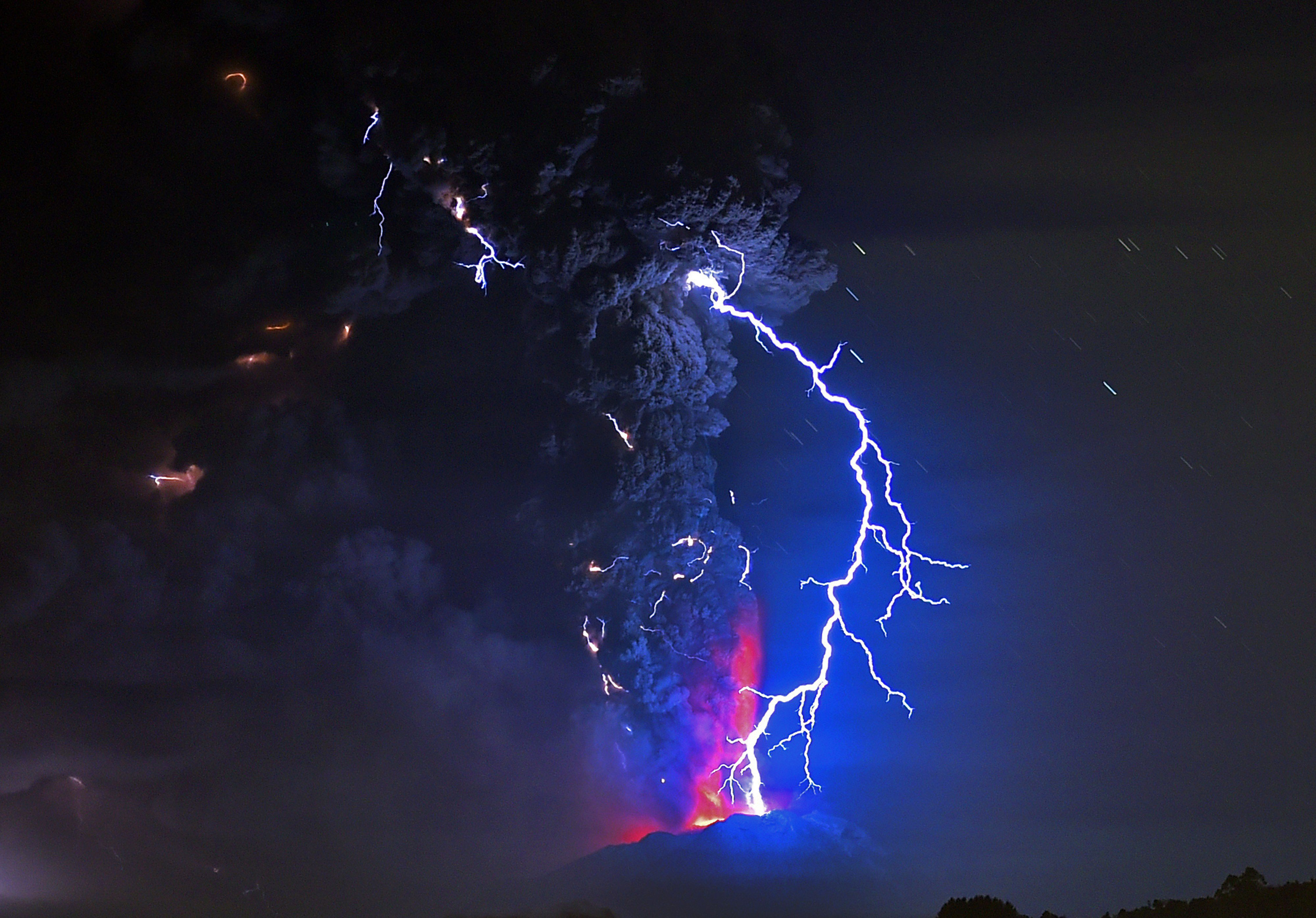 Lightning illuminates a cloud of ash as lava spews from the Calbuco volcano in southern Chile on April 23, 2015.