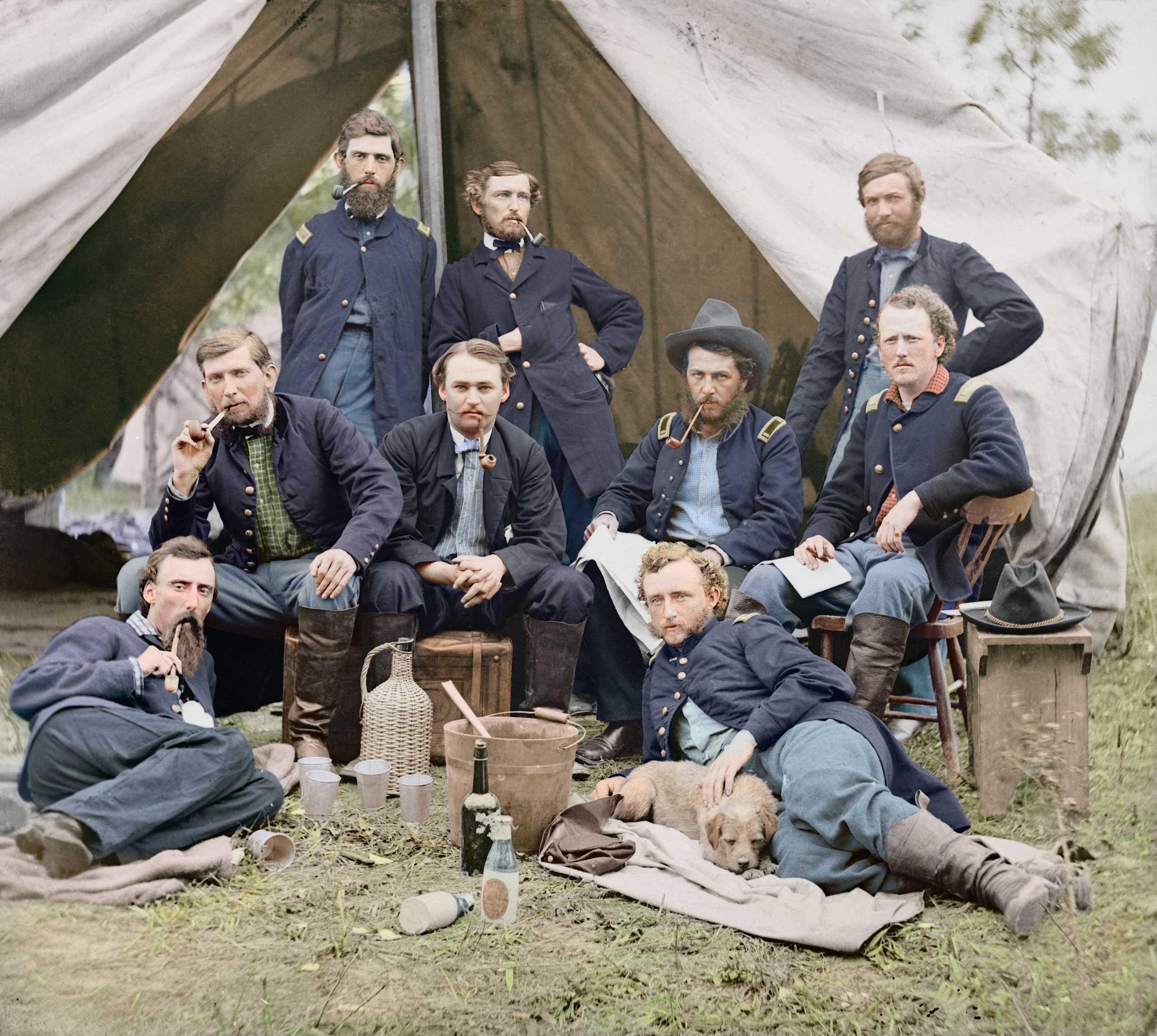 The staff of Gen. Fitz-John Porter, Lieutenant William G. Jones and George A. Custer reclining at Falmouth, Va., 1863