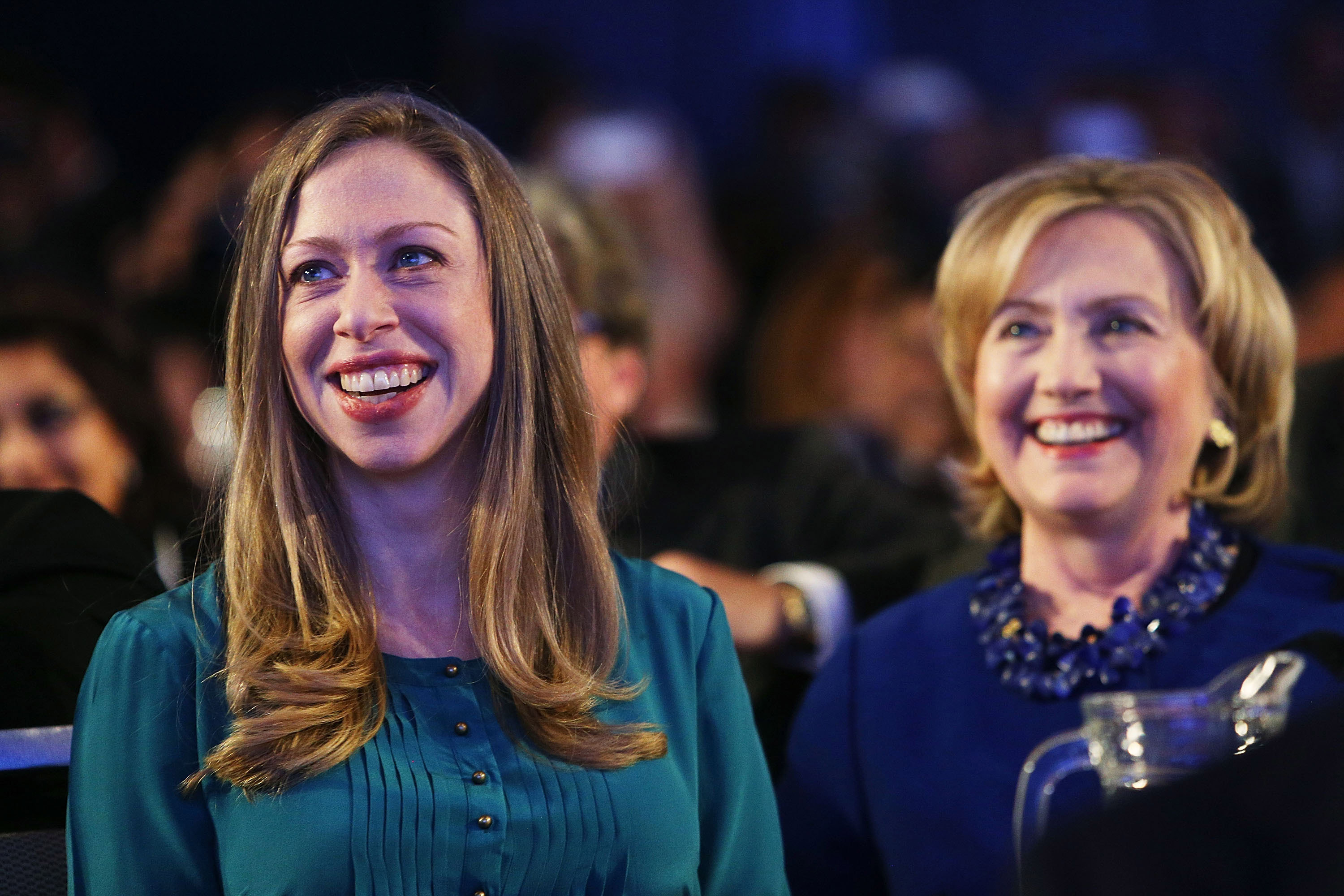 Former U.S. Secretary of State Hillary Clinton and daughter Chelsea Clinton are viewed in the audience as U.S. President Barack Obama, who is in New York City for the 69th Session of the United Nations General Assembly, speaks at the Clinton Global Initiative on September 23, 2014 in New York City.