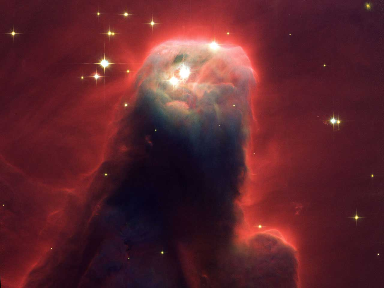 Cone Nebula:                               This monstrous pillar resides in a turbulent star-forming region. This picture shows the upper 2.5 light-years of the nebula, a height that equals 23 million roundtrips to the Moon. The entire nebula is 7 light-years long. The Cone Nebula resides 2,500 light-years away in the constellation Monoceros.                               Imaged released on April 30, 2002.