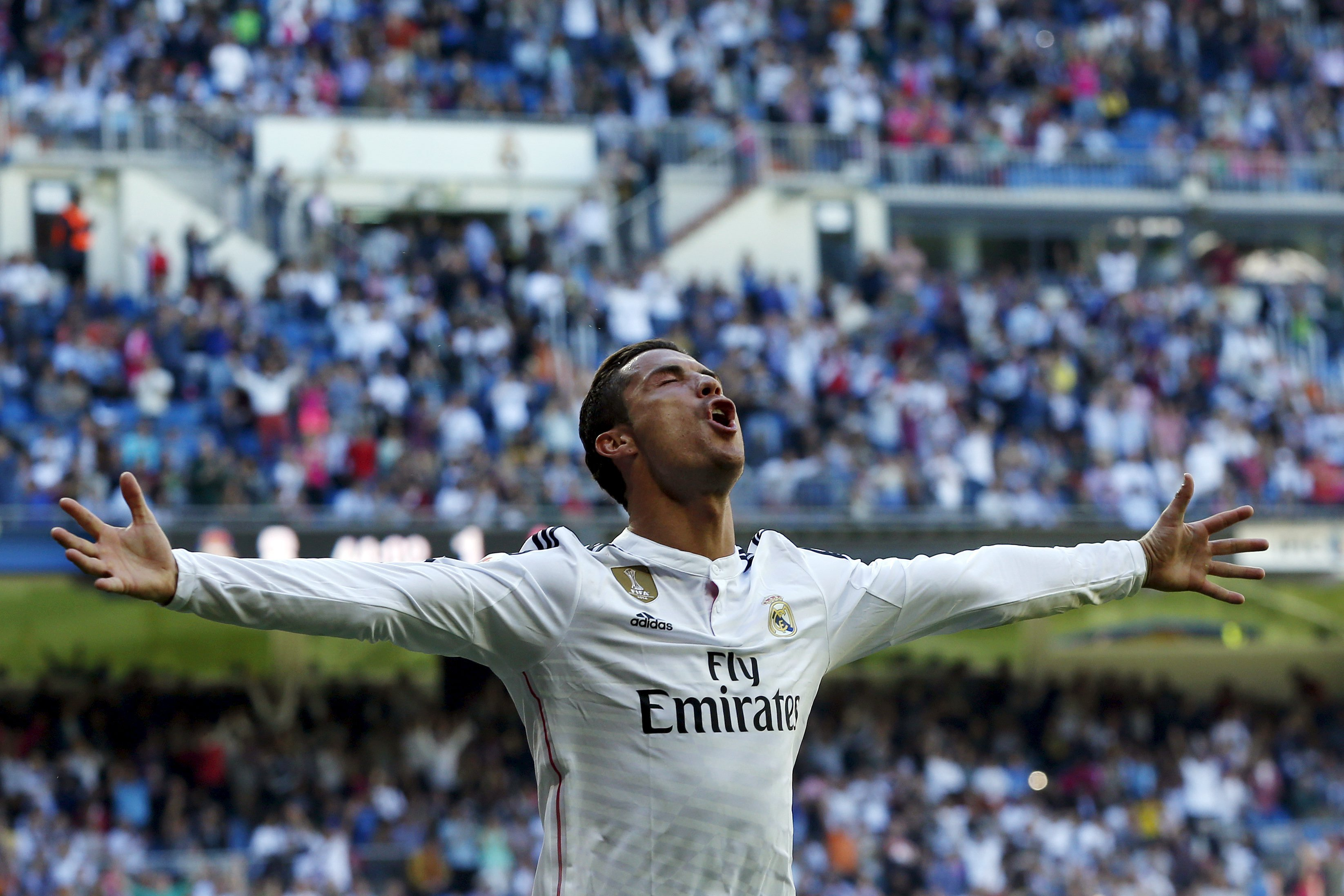 Real Madrid's Cristiano Ronaldo celebrates his fifth goal against Granada during their Spanish first division soccer match at Santiago Bernabeu stadium in Madrid on April 5, 2015.