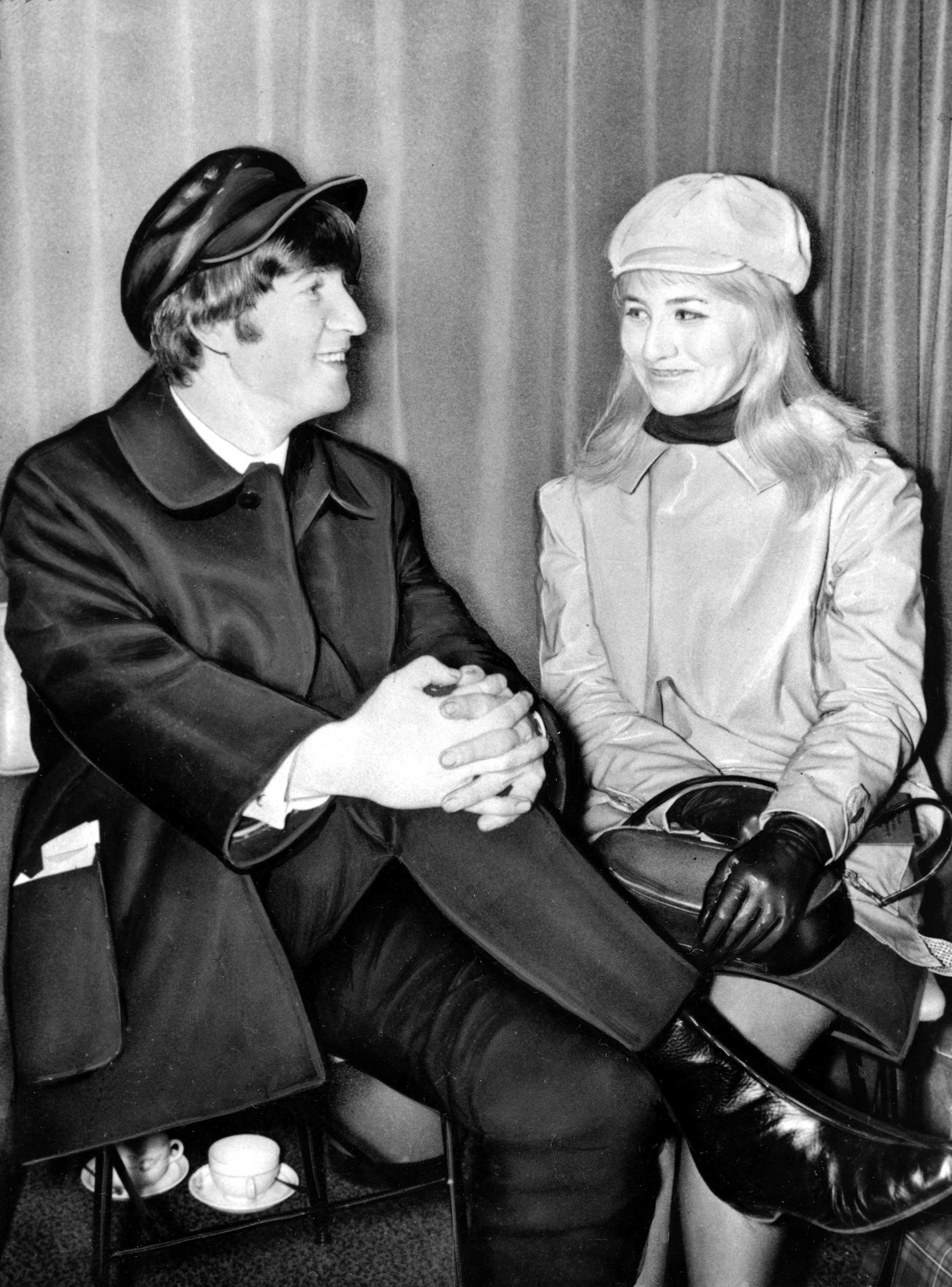 Beatle John Lennon and his wife, Cynthia, sit in London Airport, England, before flying to the U.S. on Feb. 7, 1964.