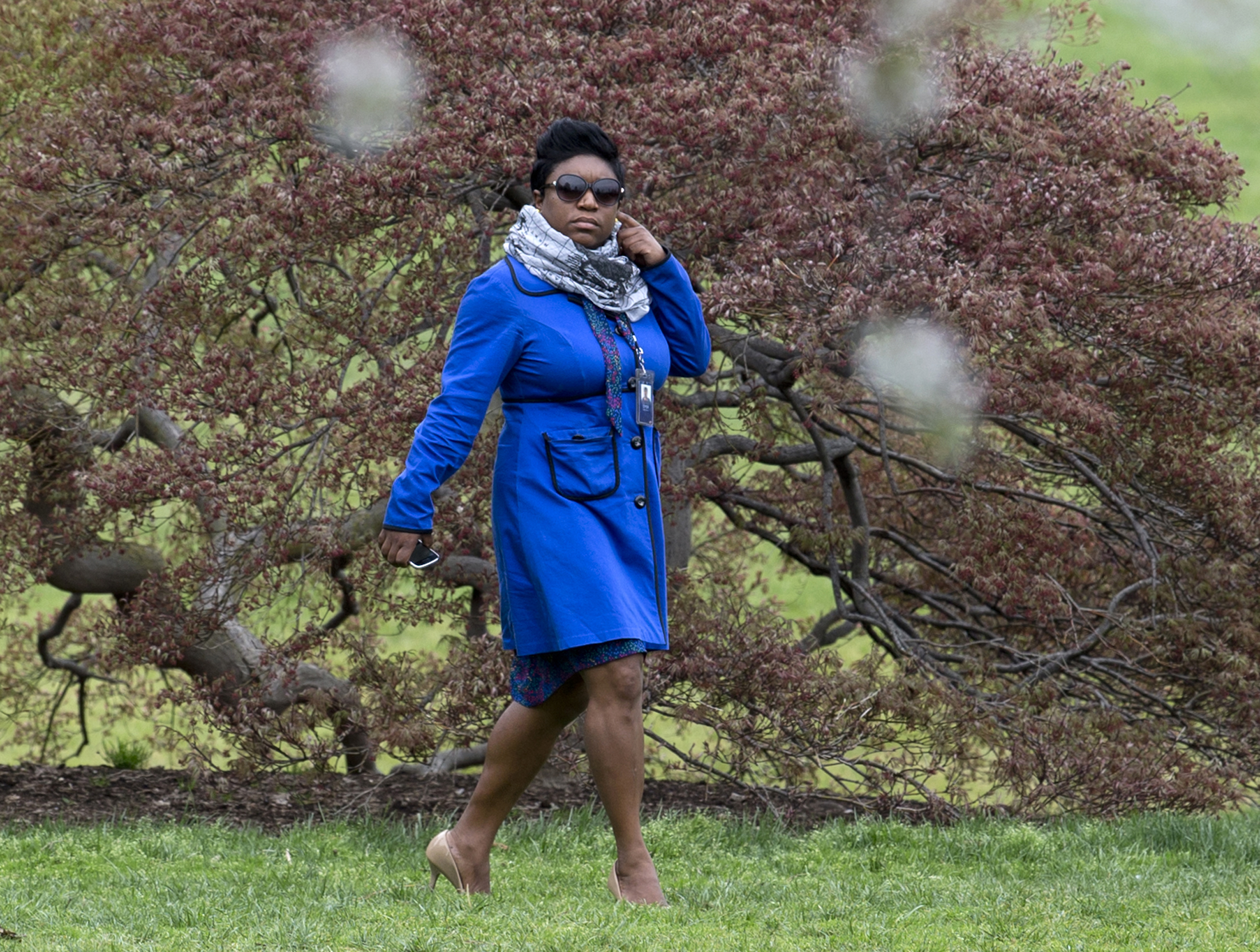 In this photo taken April 15, 2015, Deesha Dyer walks across the South Lawn of the White House in Washington to attend the seventh annual White House Kitchen Garden Planting with first lady Michelle Obama.