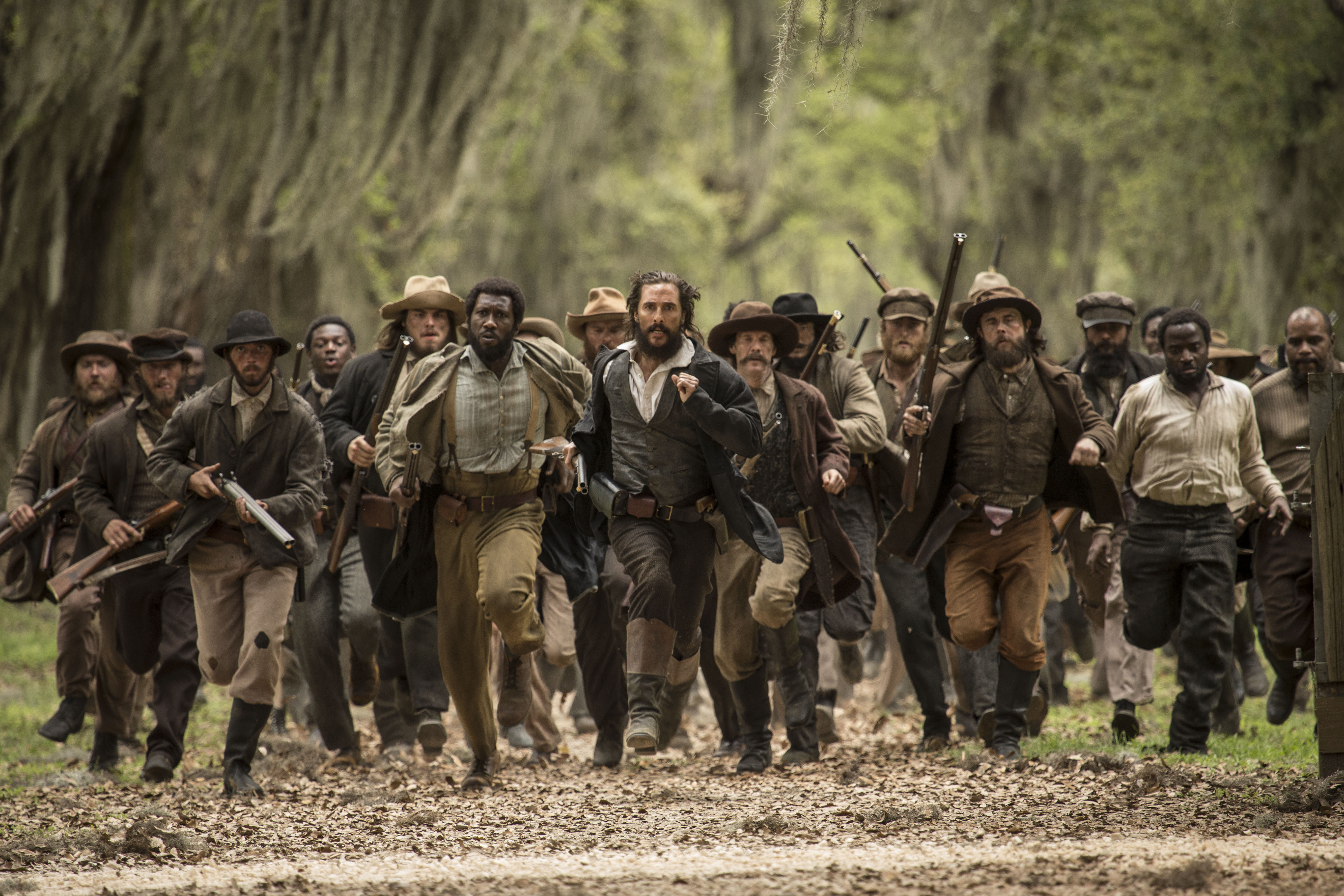 Matthew McConaughey (center) and Mahershala Ali (center left) star in The Free State of Jones