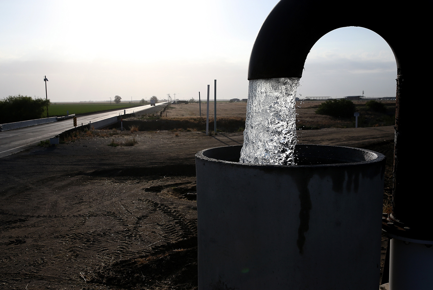 Well water is pumped from the ground on April 24, 2015 in Tulare, California.