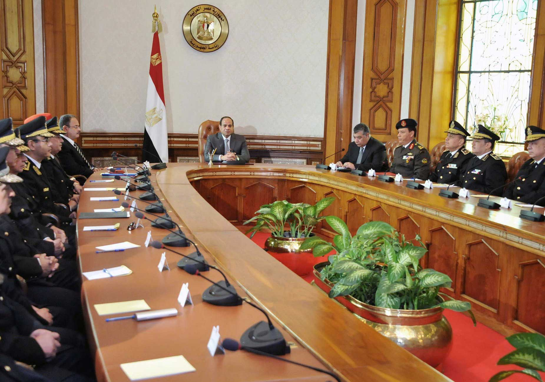 President Abdul Fattah al-Sisi meeting with his Interior Minister Magdy Abdel Ghaffar, left, the chief of intelligence and military officials in Cairo on April 16, 2015