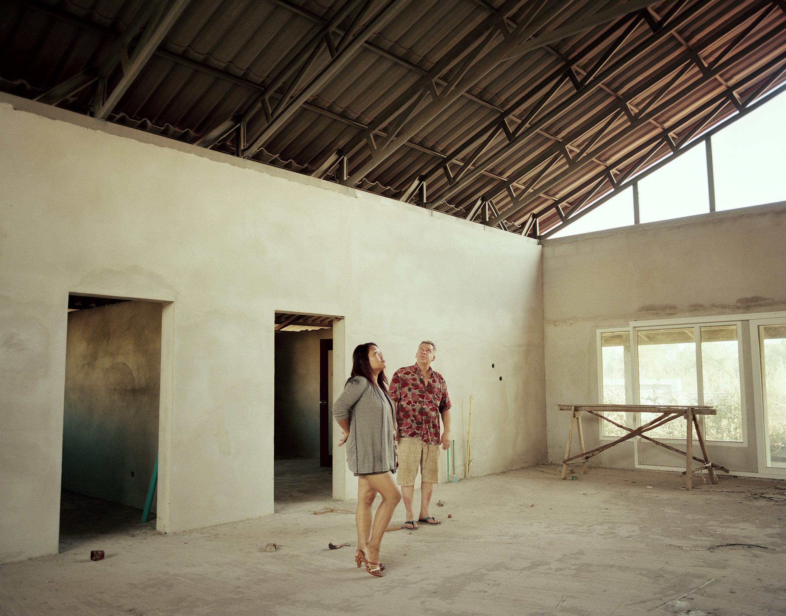 Bertil and Kong inside their partially built holiday house, Chum Phae, 2012.