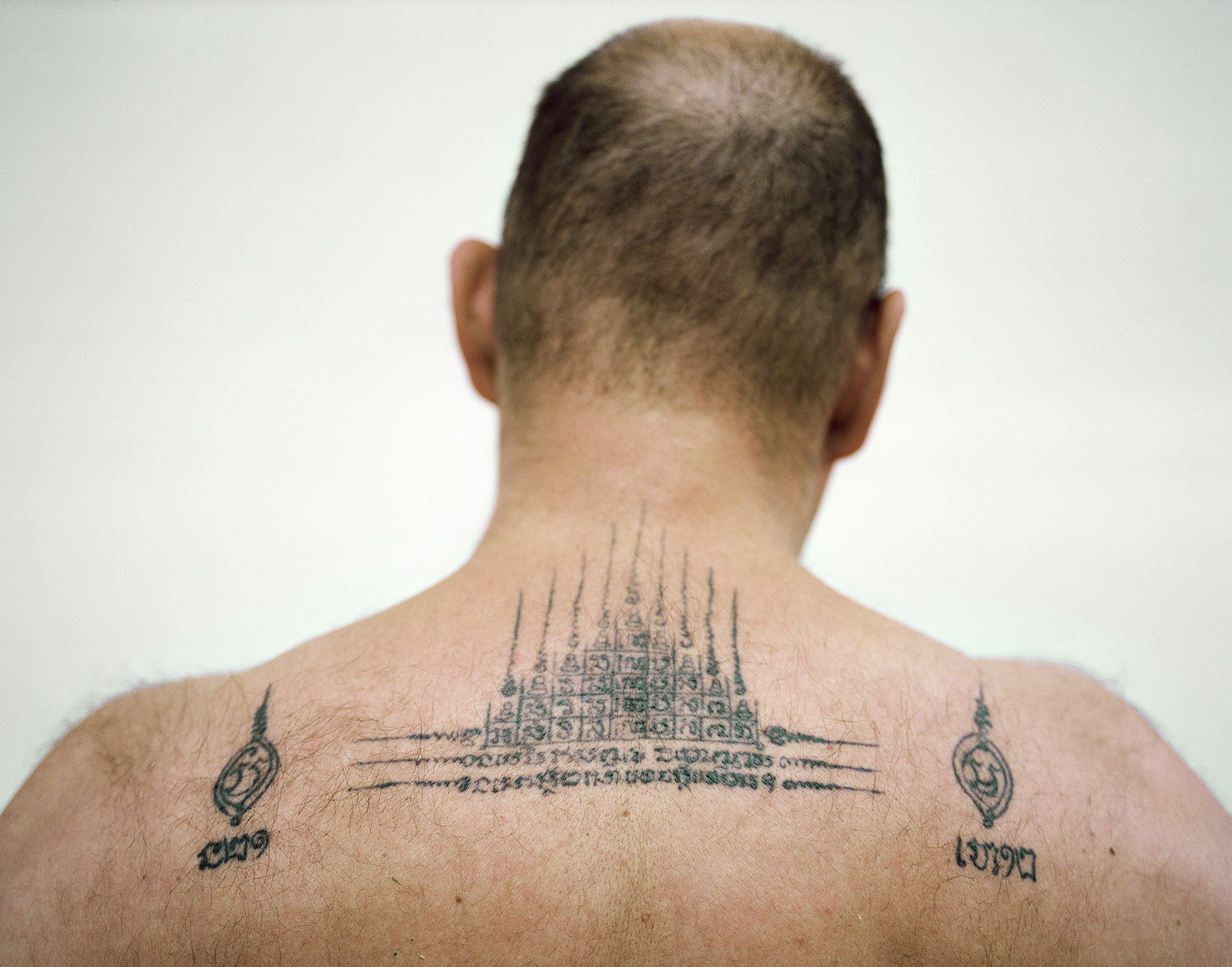 Peter's Buddhist tattoos, which bring luck and protect against knife wounds, Kaeng Khro, 2012.