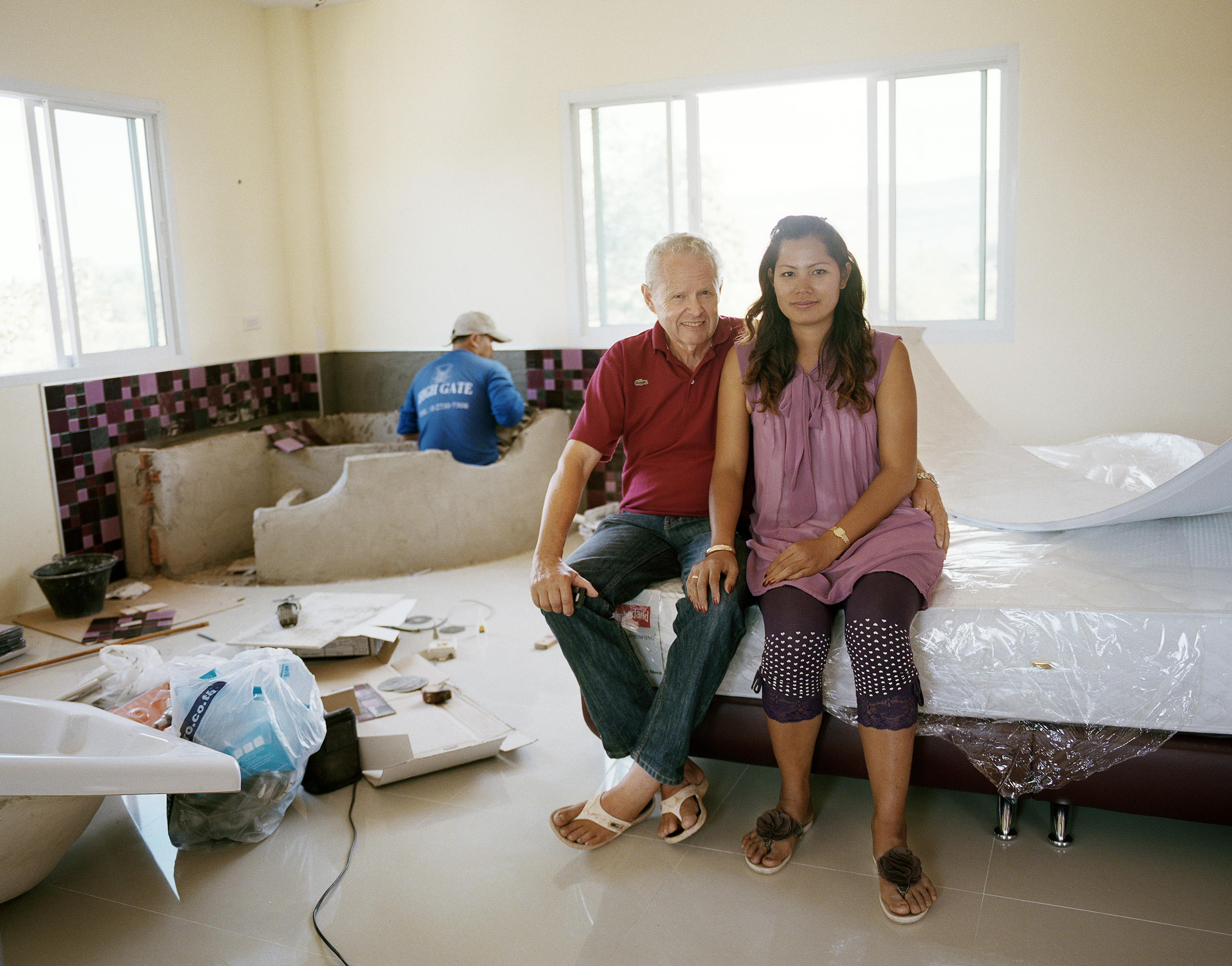 Erling and Aorratai, who are expecting a child, are installing a hot tub in the bedroom of the big European-style house they are building in Kaeng Khro, 2012.