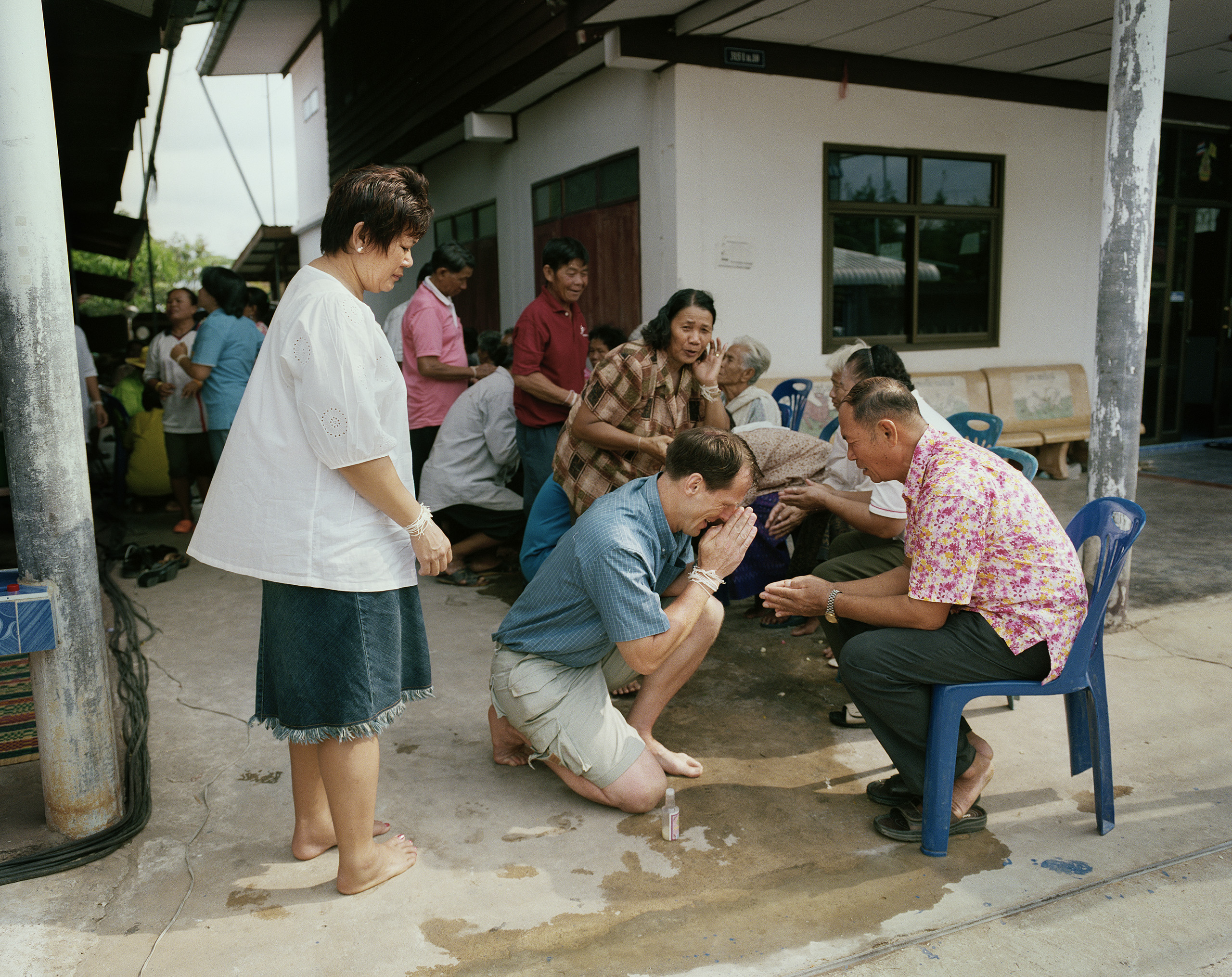 Pereric and Sombat pay their respects to the elders of the neighborhood in conjunction with Songkran, the Thai New Year, Kaeng Khro 2010.