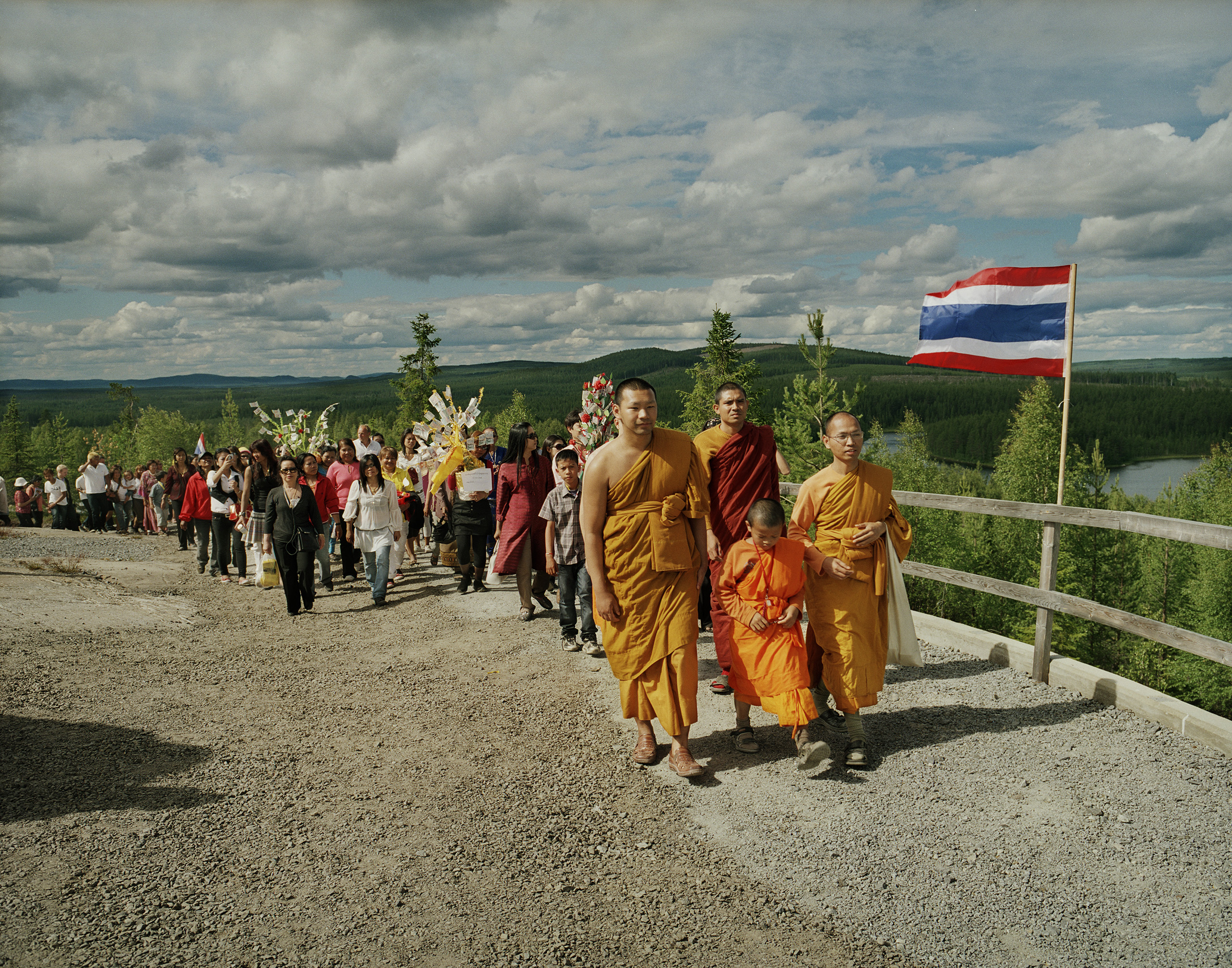 Ceremony on the temple mount, Fredrika, 2008. A Thai Buddhist monk living in Stockholm is planning to build Europe's largest Buddhist temple in Fredrika. Every year he arranges ceremonies to collect money to the temple construction. It has become a meeting point for many Thai women in Sweden.