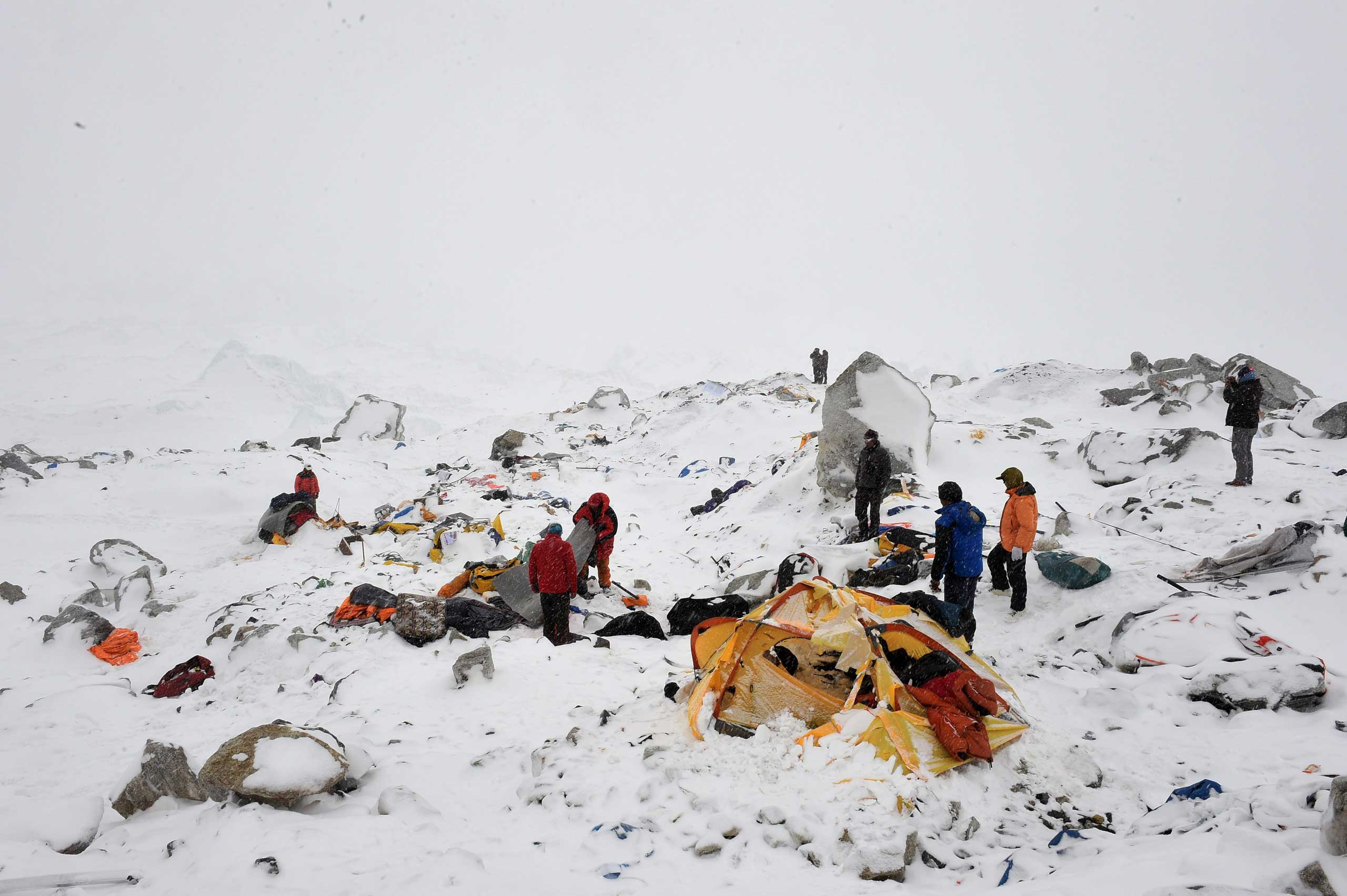 Rescuers look for survivors after the avalanche that was triggered by an earthquake outside Kathmandu, Nepal, on April 25, 2015.