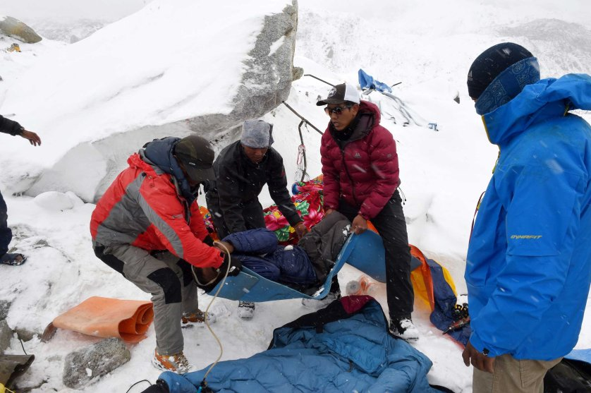 Rescuers help a porter onto a makeshift stretcher after he was injured by the avalanche on Mount Everest, triggered by an earthquake outside Kathmandu, Nepal.