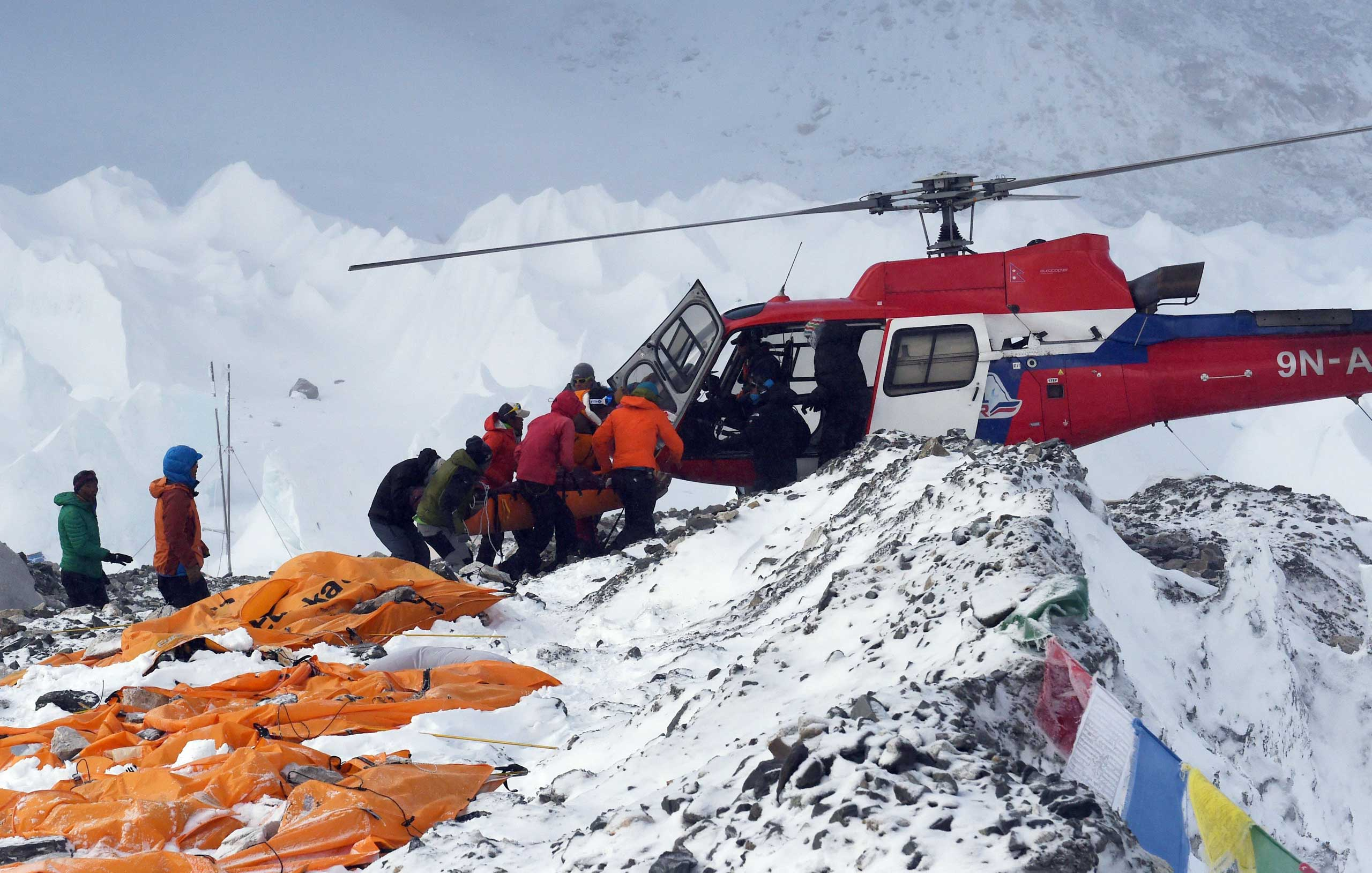 An injured person is loaded onto a rescue helicopter at Everest Base Camp on April 26, 2015.